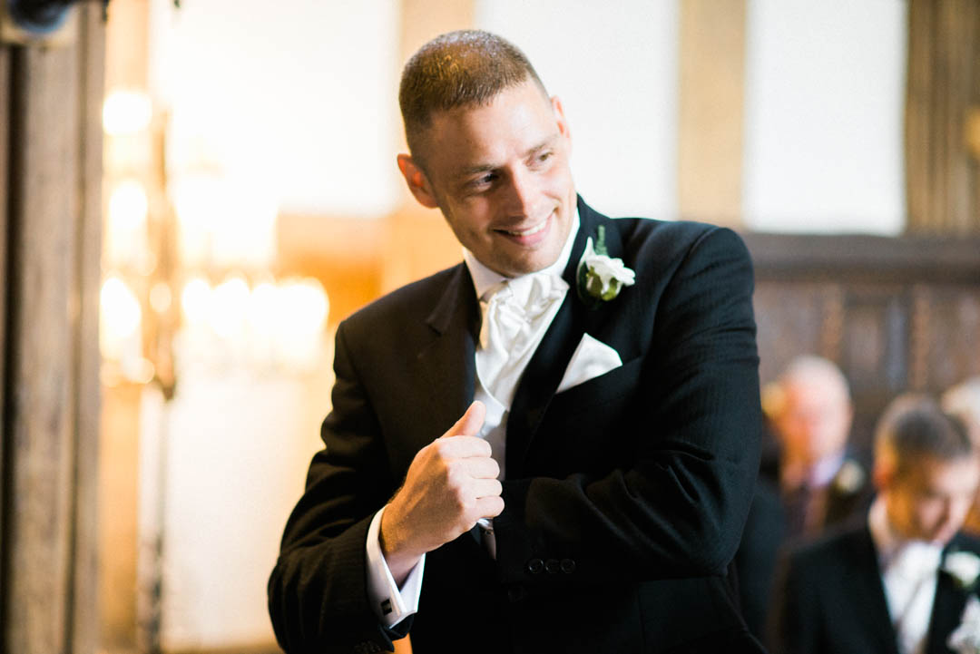 Groomsman hunts for the ring at Ordsall Hall Wedding Venue