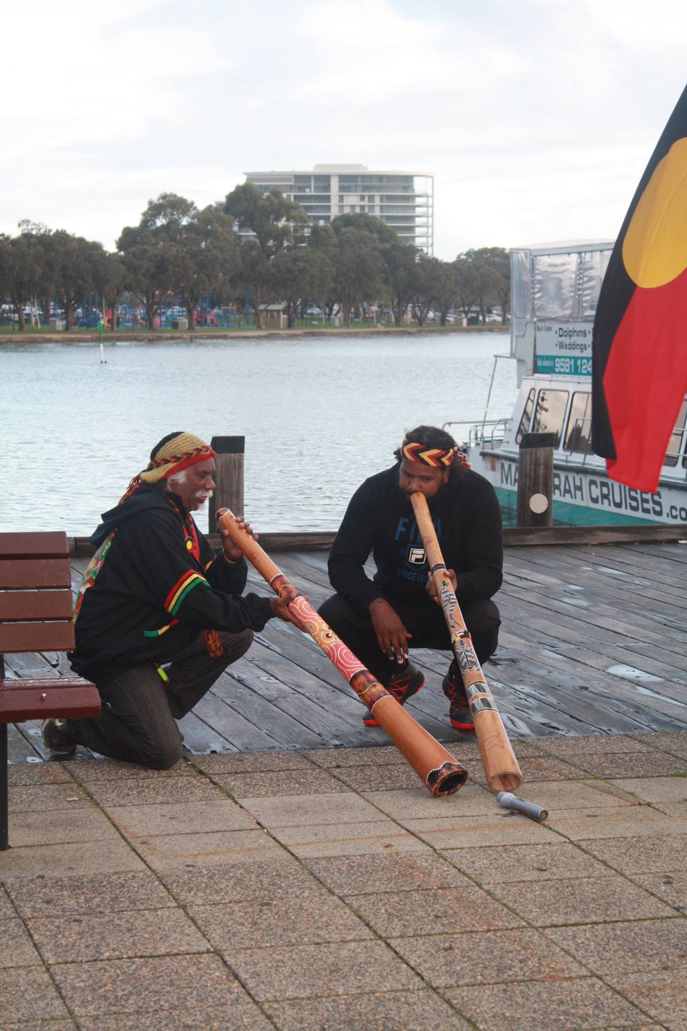 Didgeridoo's sang as the flags were raised.