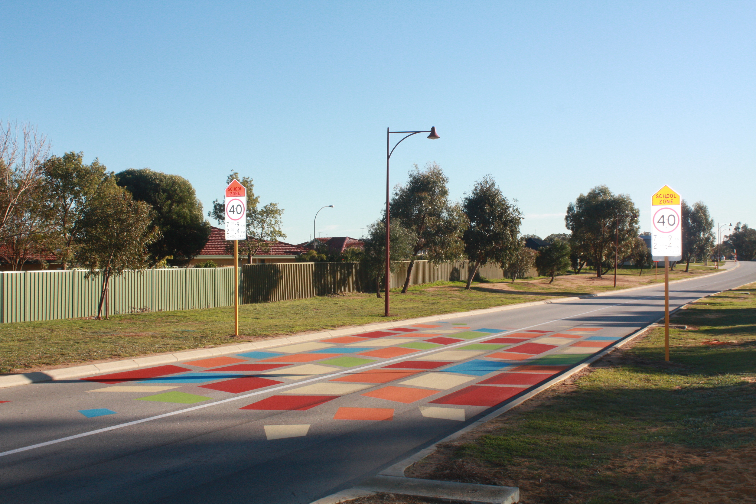 The city is trialling 'coloured shapes' on the road in Meadow Springs near the primary school