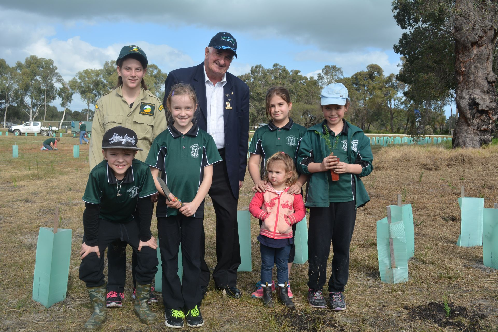 Waroona Primary School students and Shire President Cr. Wally Barrett planting trees copy.jpg