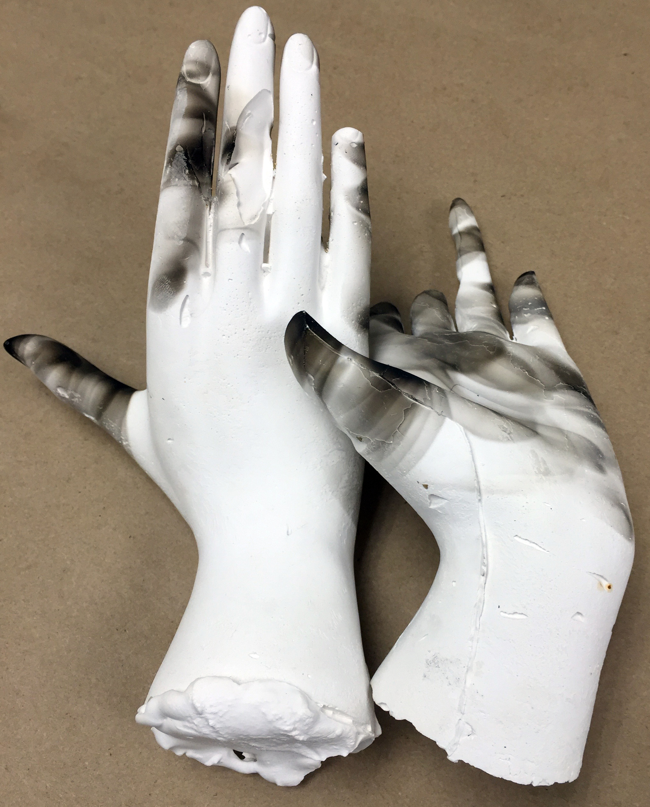 Plaster hands with smoke