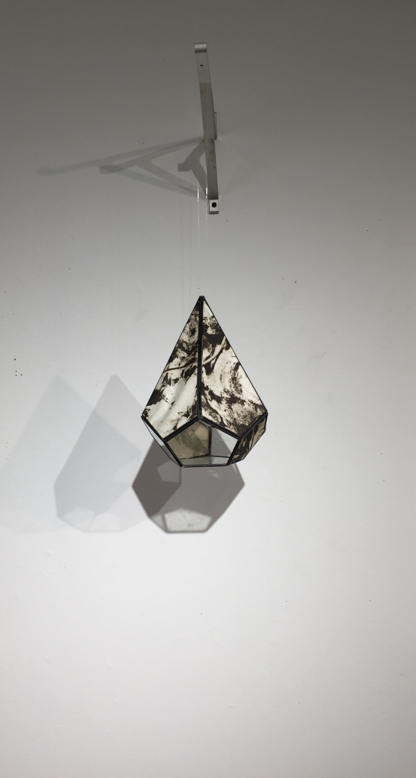 Photo Polymer prints within geometric metal form