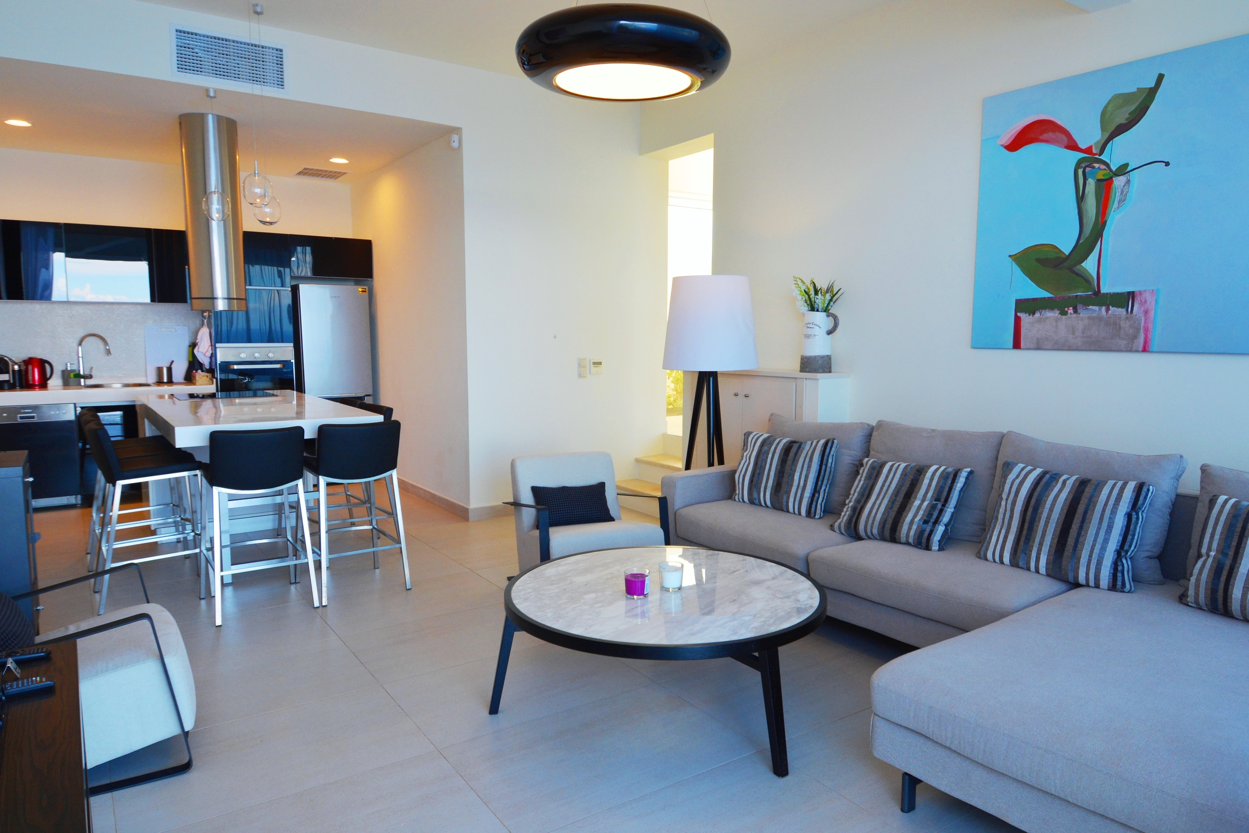 Stylish living rooms and a well equipped modern open kitchen.