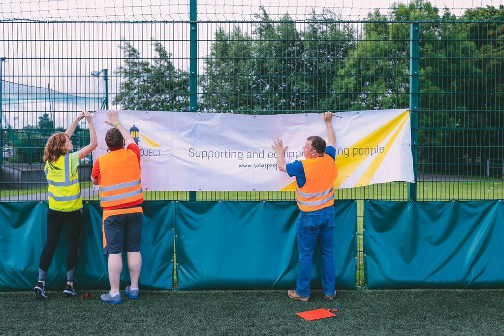 Getting the Solas Project banner up; 'Supporting and equipping young people'.