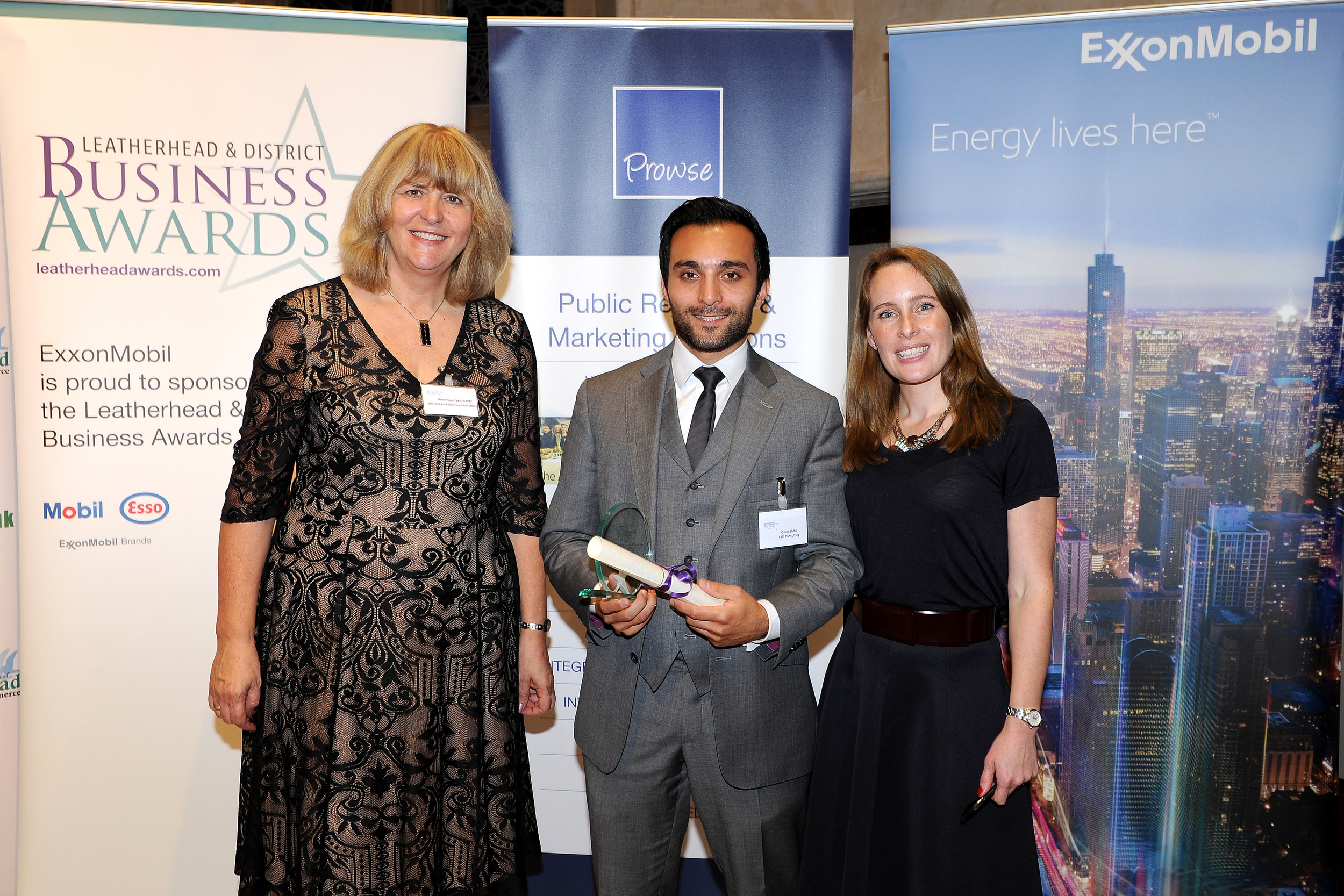 Omar Shibli collecting ETD's award from Rosemary French OBE, Executive Director at The Gatwick Diamond Initiative which sponsored the International Business of the Year category, and Clare Cowan from BBC Radio Surrey