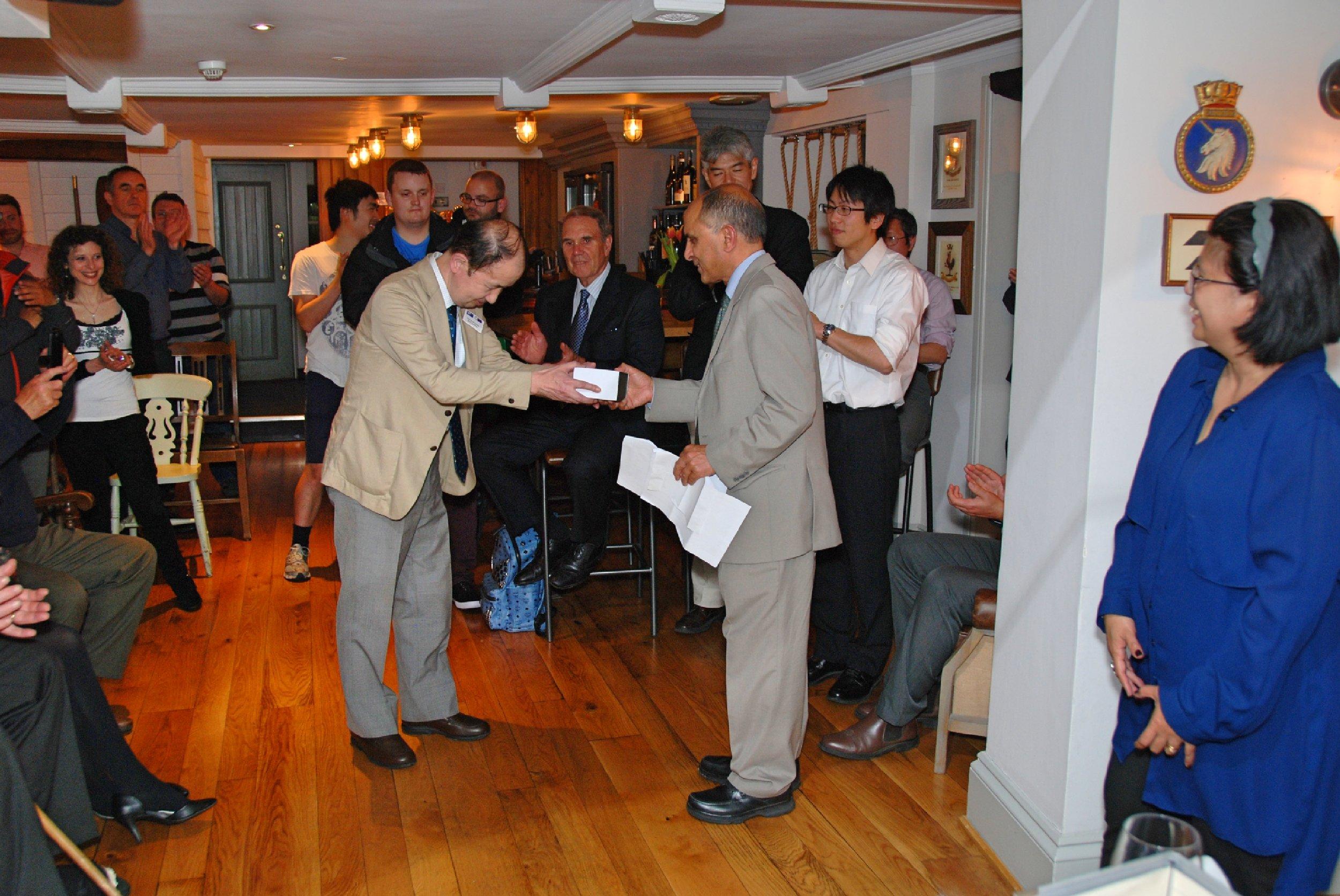 Award being presented to Prof. Kazunari Fujiyama of Meijo University, Japan