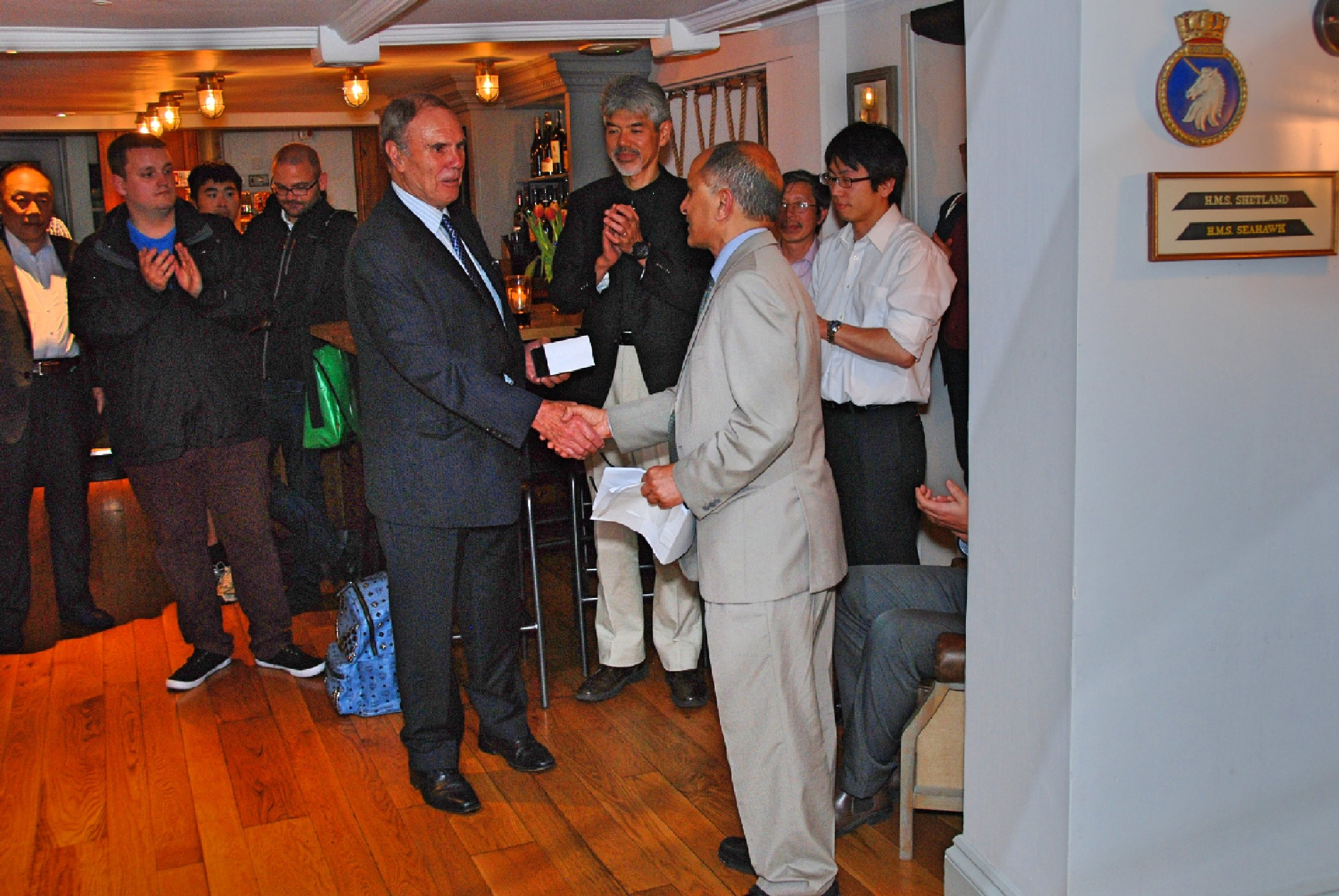 Award being presented to Mr. Bill Moore, ETD Consultant, UK