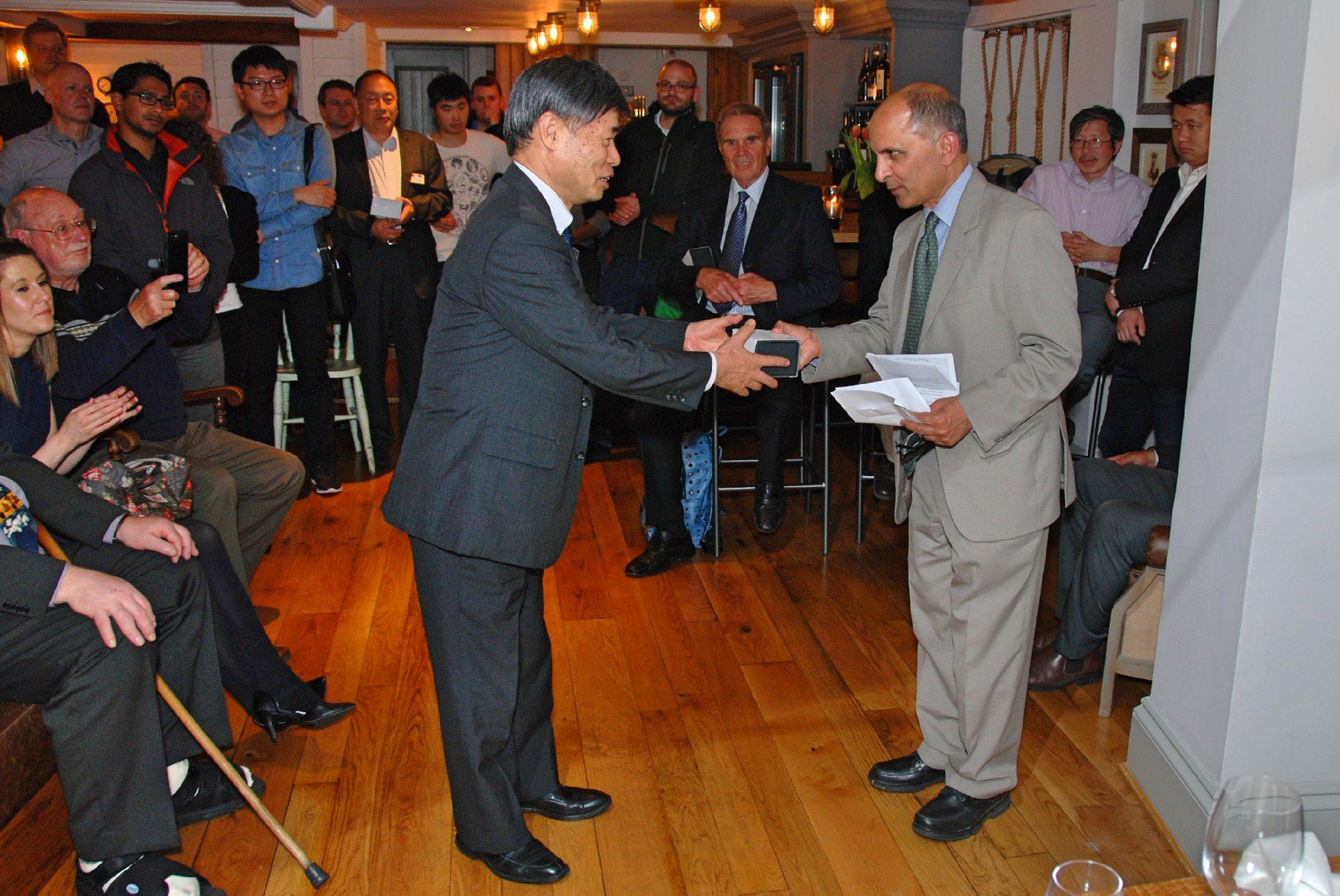 Award being presented to Prof. Yomei Yoshioka of Ehime University, Japan