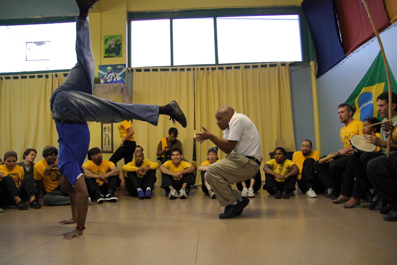 Silvio dos Reis and student in a Capoeira game, Seattle, WA.