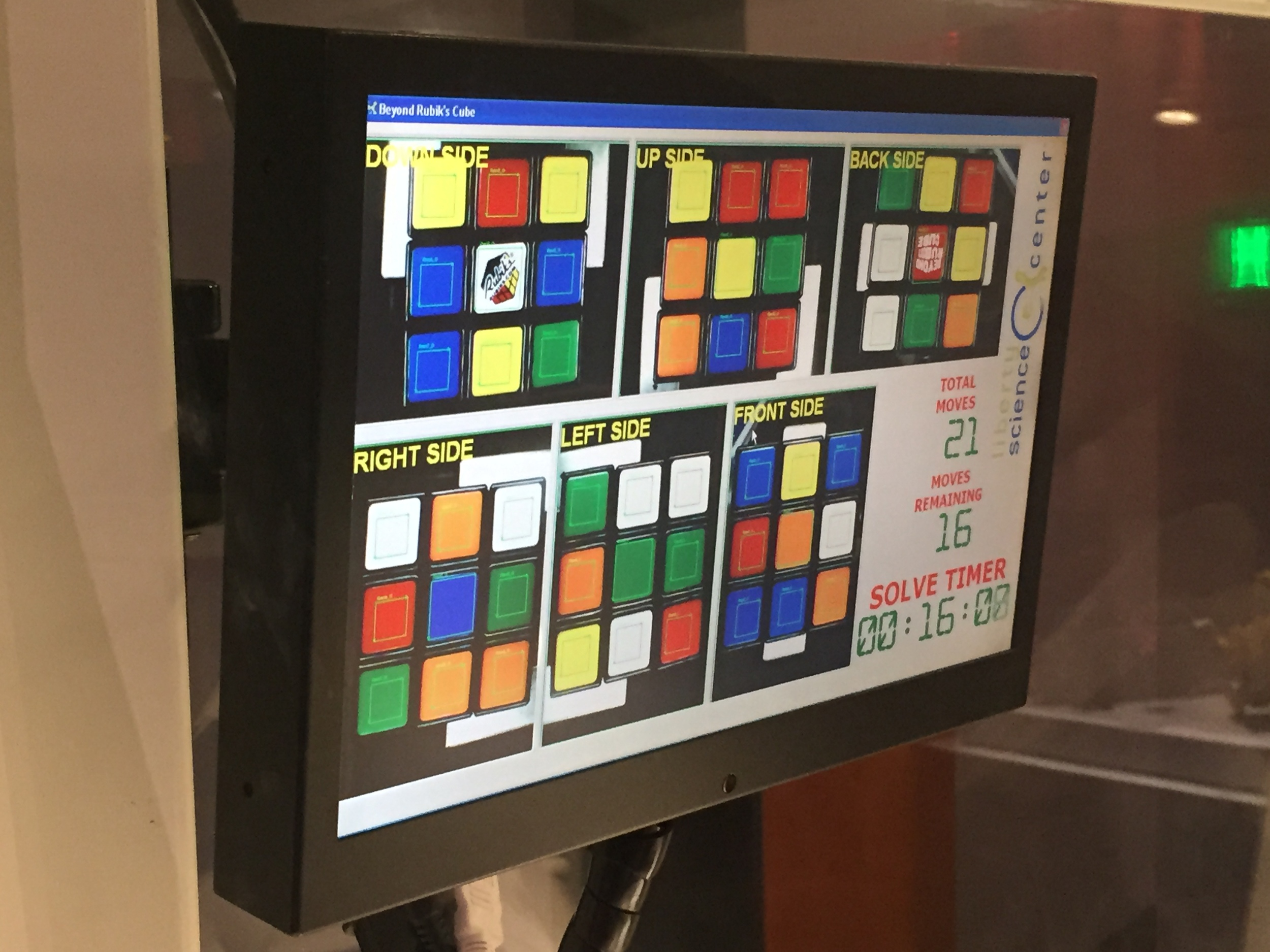 Screen display of the six sides of the cube the machine had to solve for along with total moves needed and timer