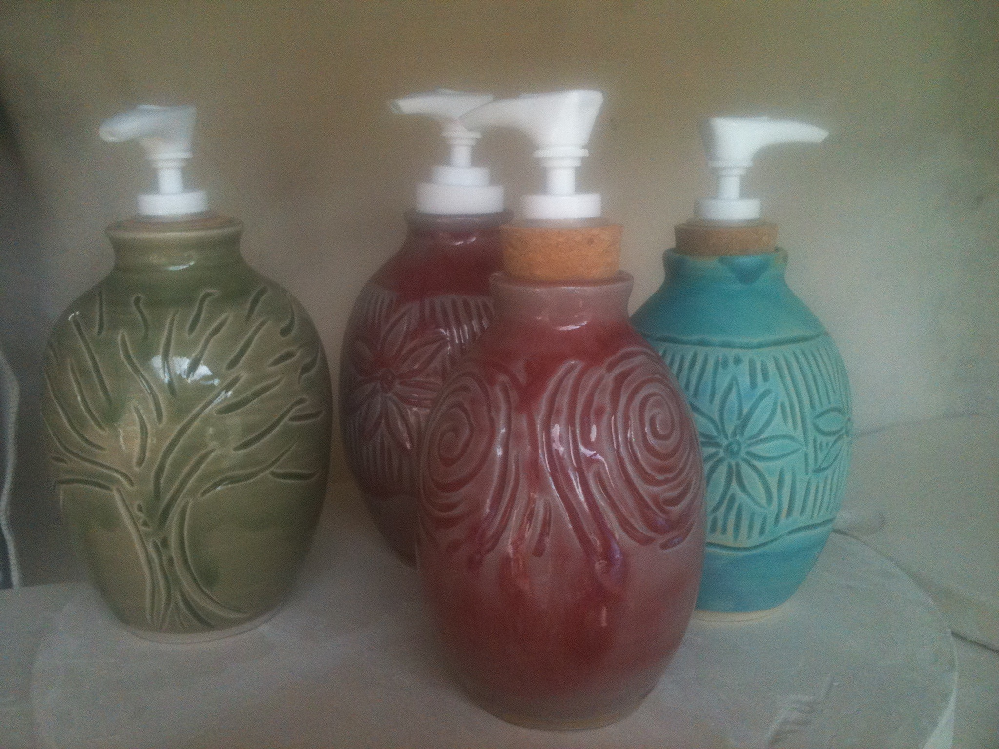 Carved lotion/soap dispensers