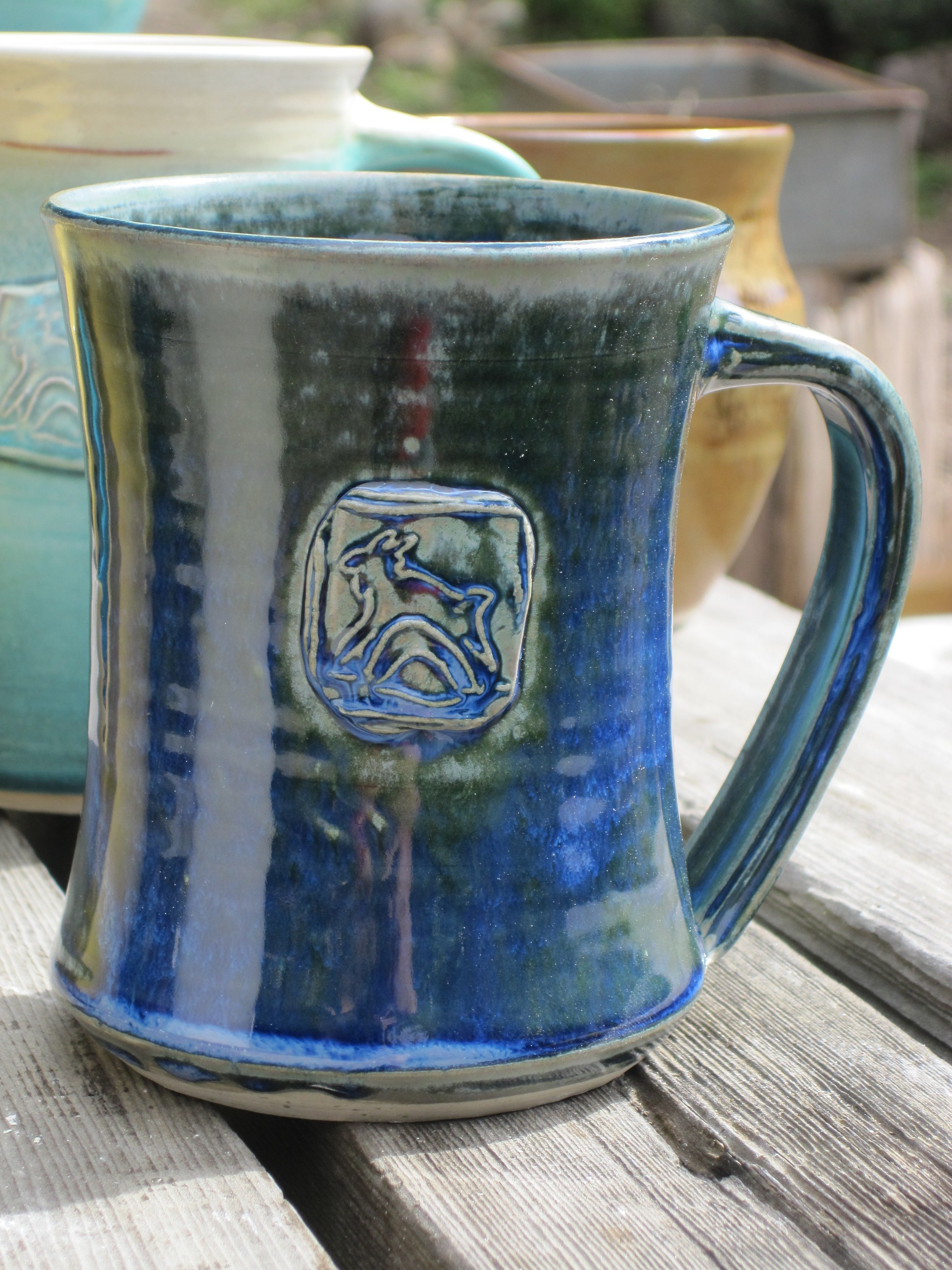 Harley Farms jumpy goat logo mugs