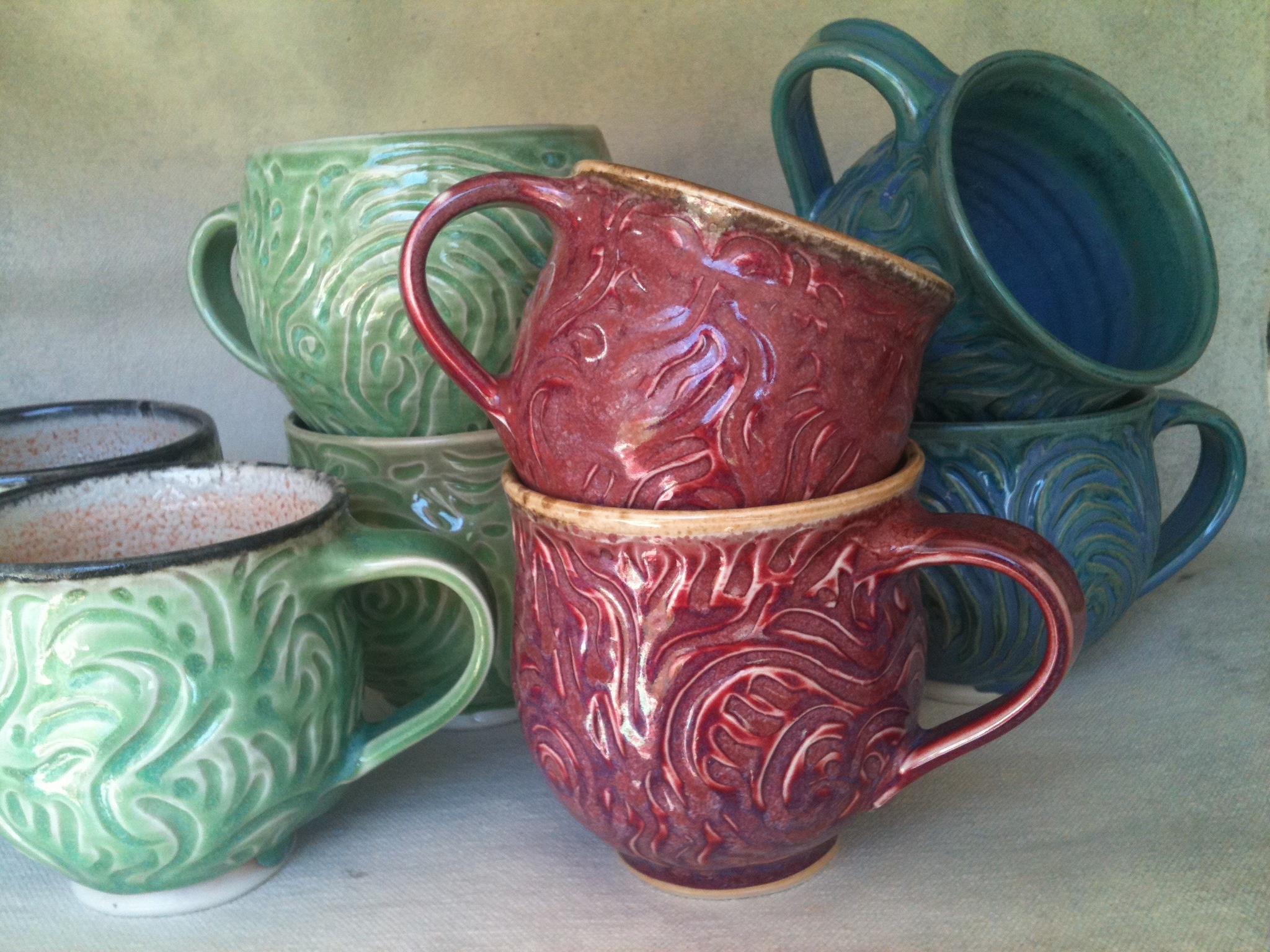 Carved porcelain mugs