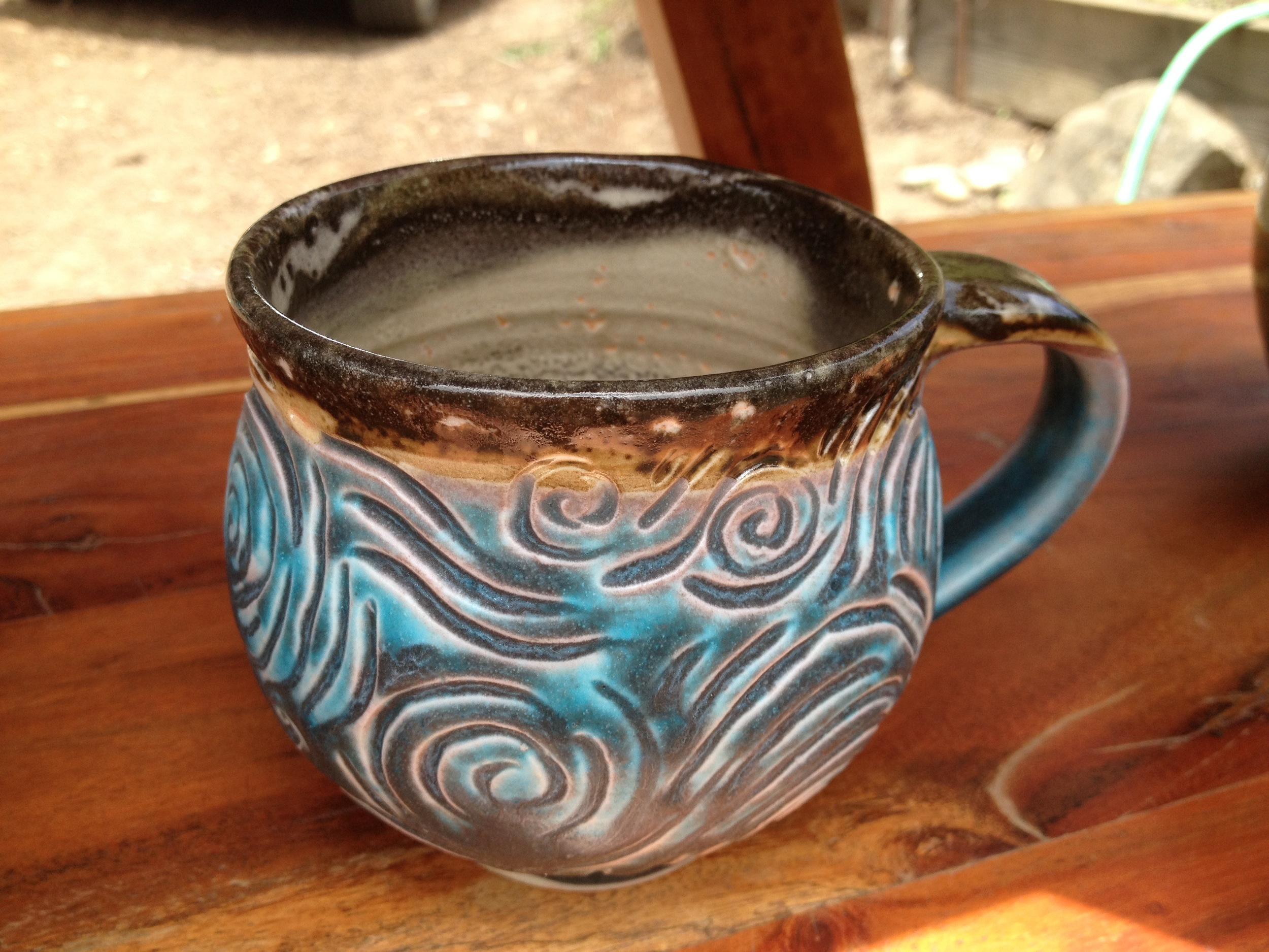 Colorful carved mug