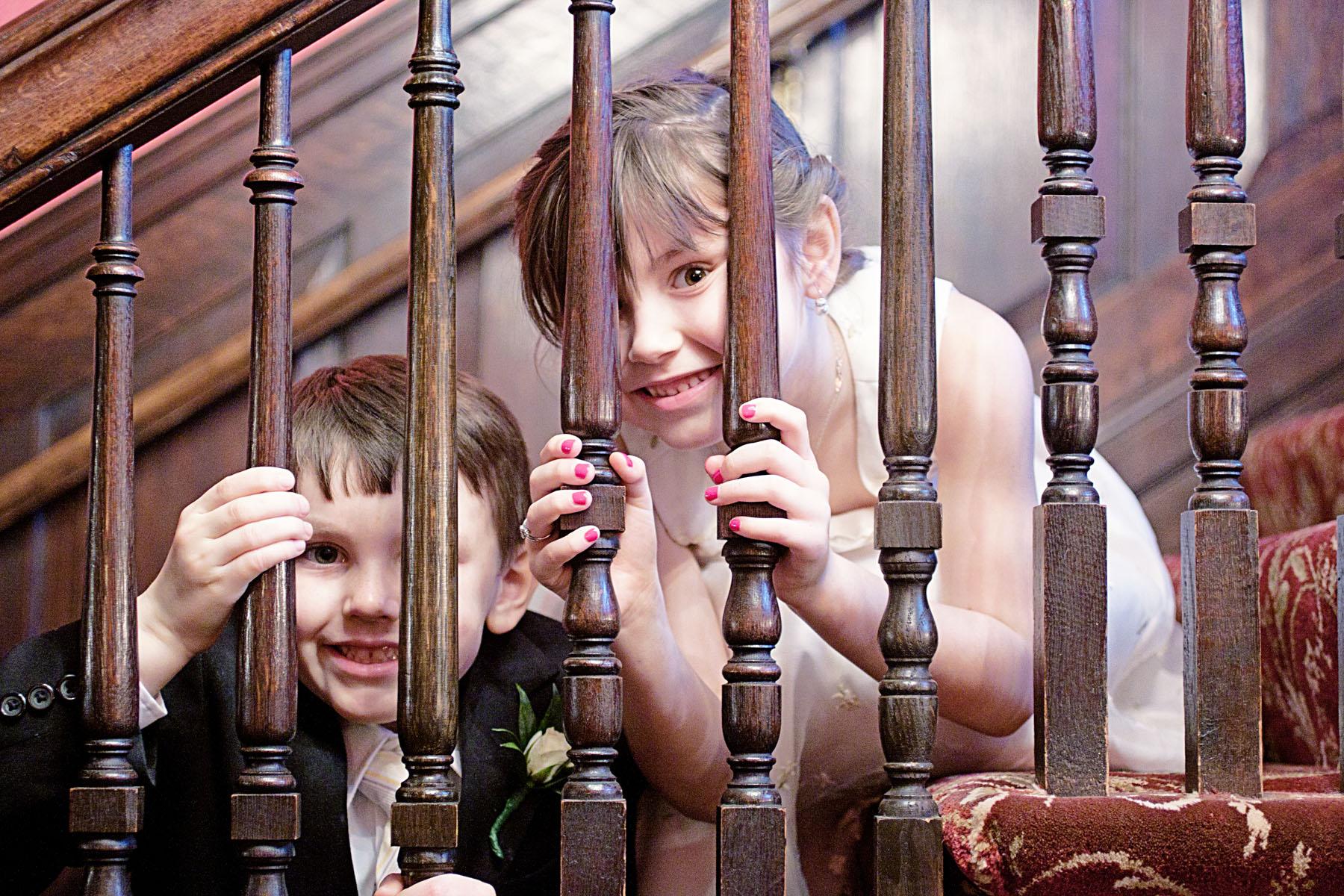 kids_lookingthroughstaircase_2.jpg