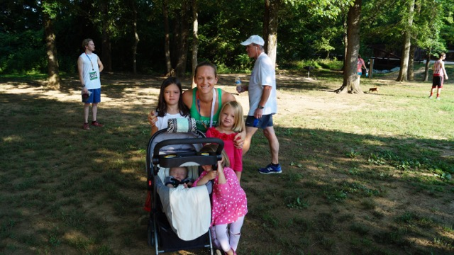 Coach Sara with her kids after running a 5K.
