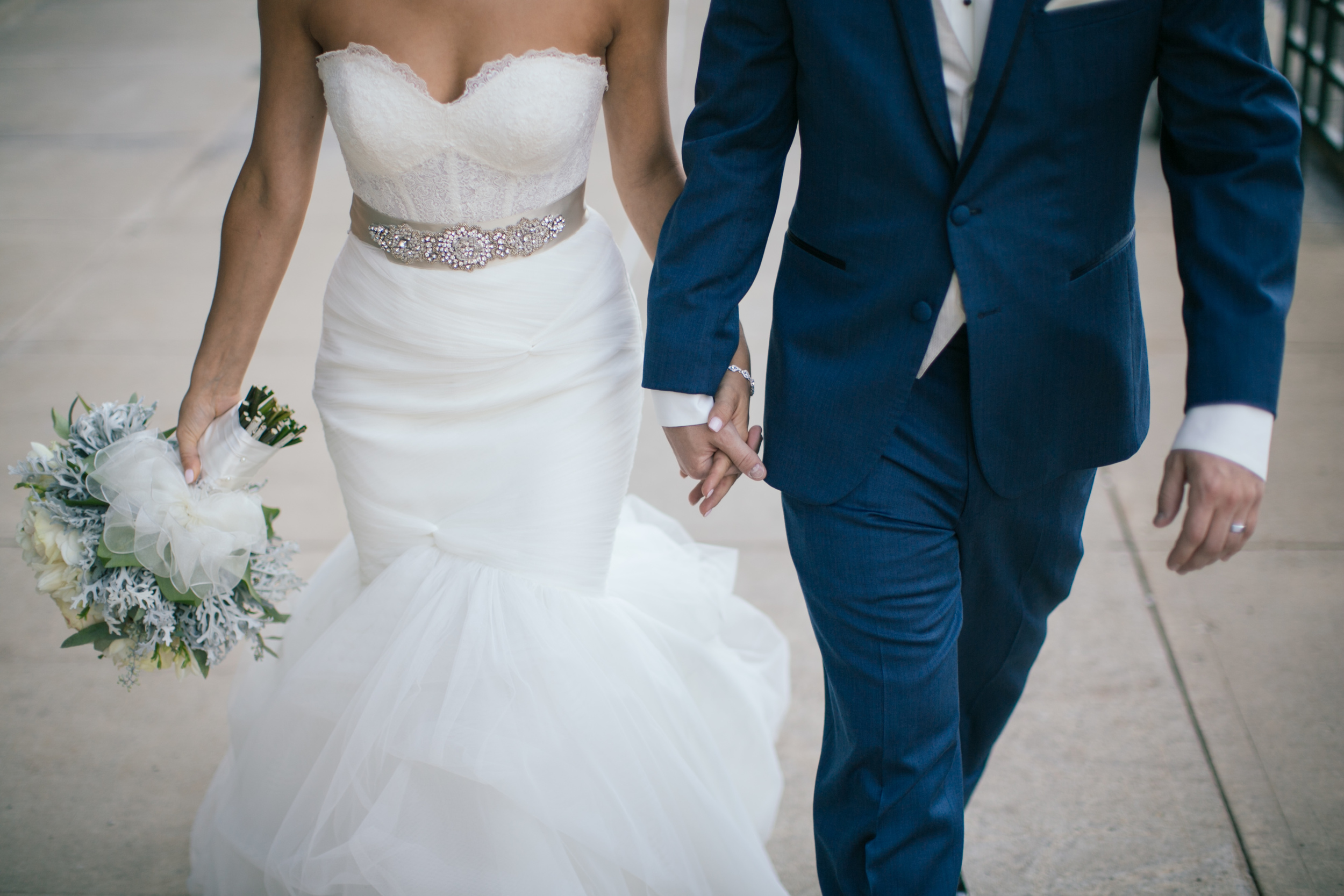 Ashley+Aaron_Acowsay_Cinema_Milwaukee_Wisconsin_Wedding_Holding_Hands.jpg