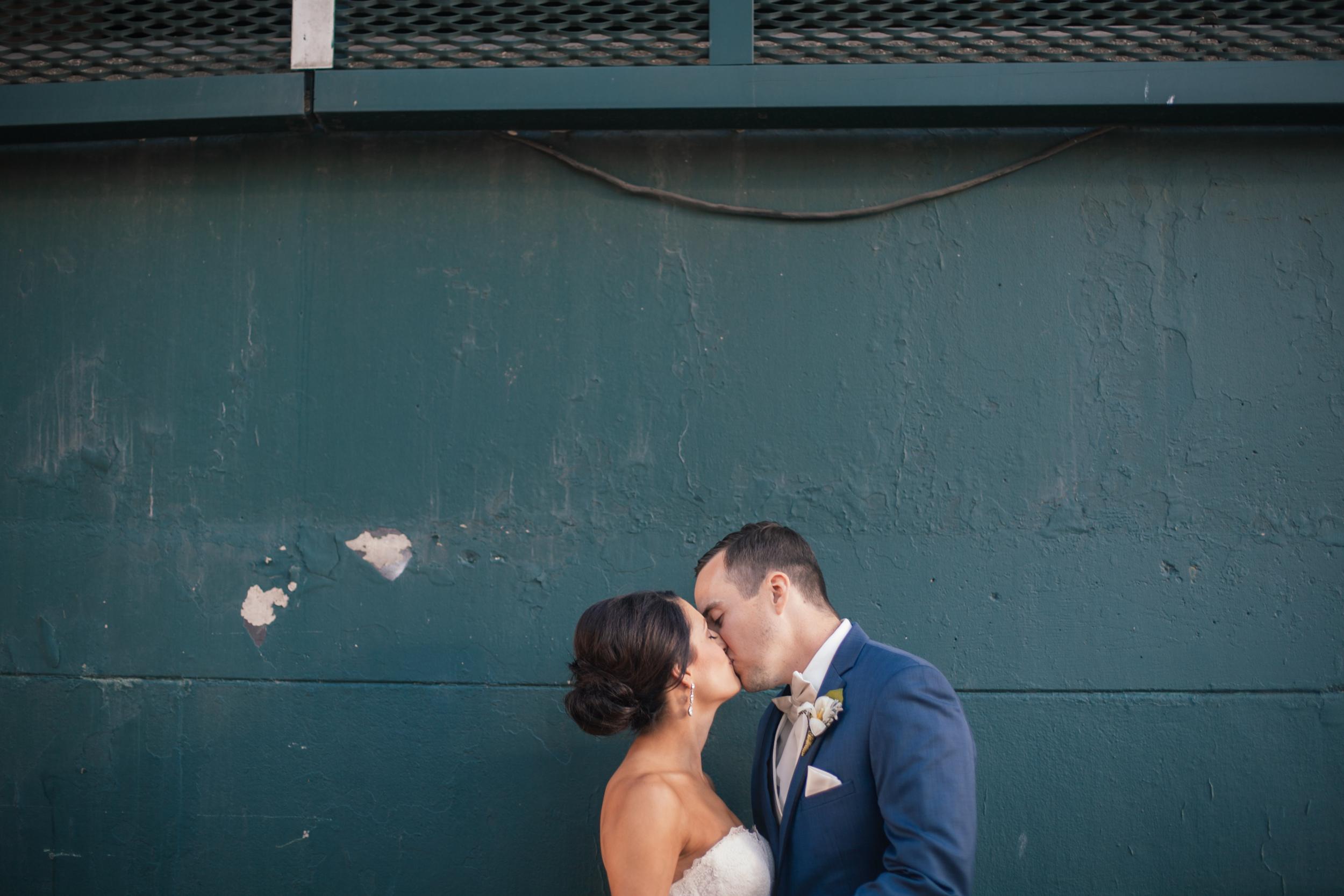 Ashley+Aaron_Acowsay_Cinema_Milwaukee_Wisconsin_Wedding_Kissing.jpg