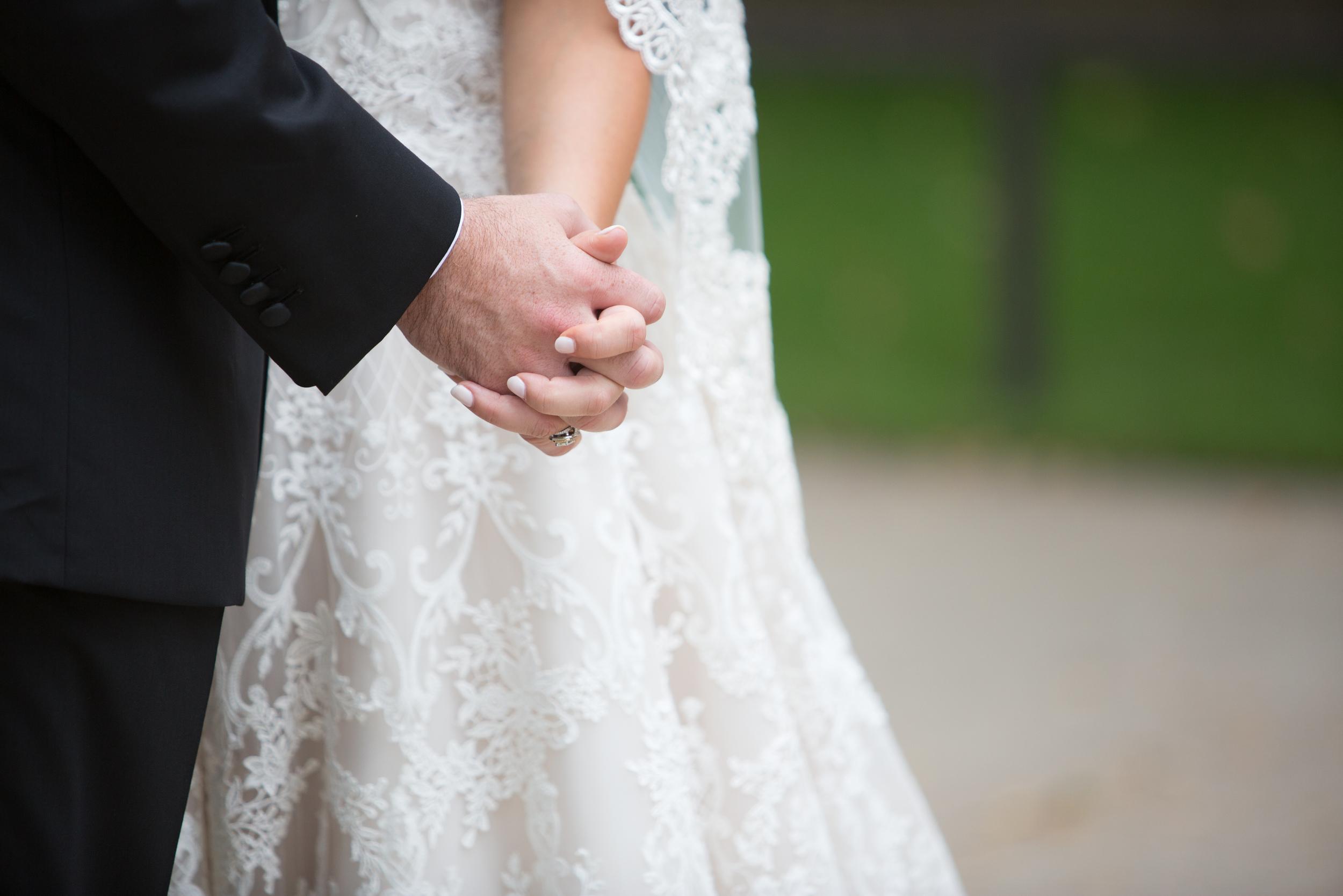 Acowsay_Cinema_MN_Wedding_Holding_hands.jpg