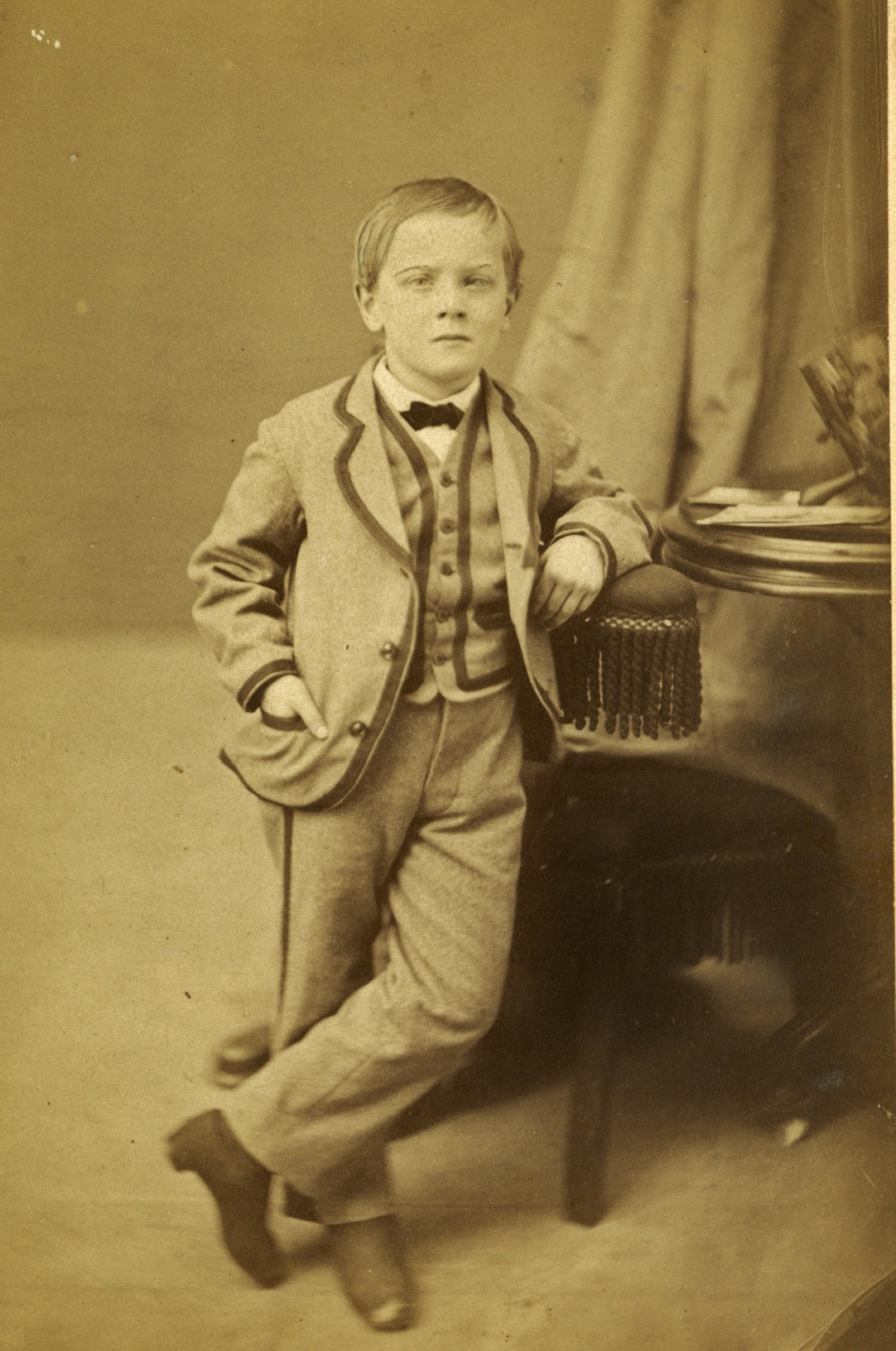 Style of child's suit sold at Pearce & Marett's