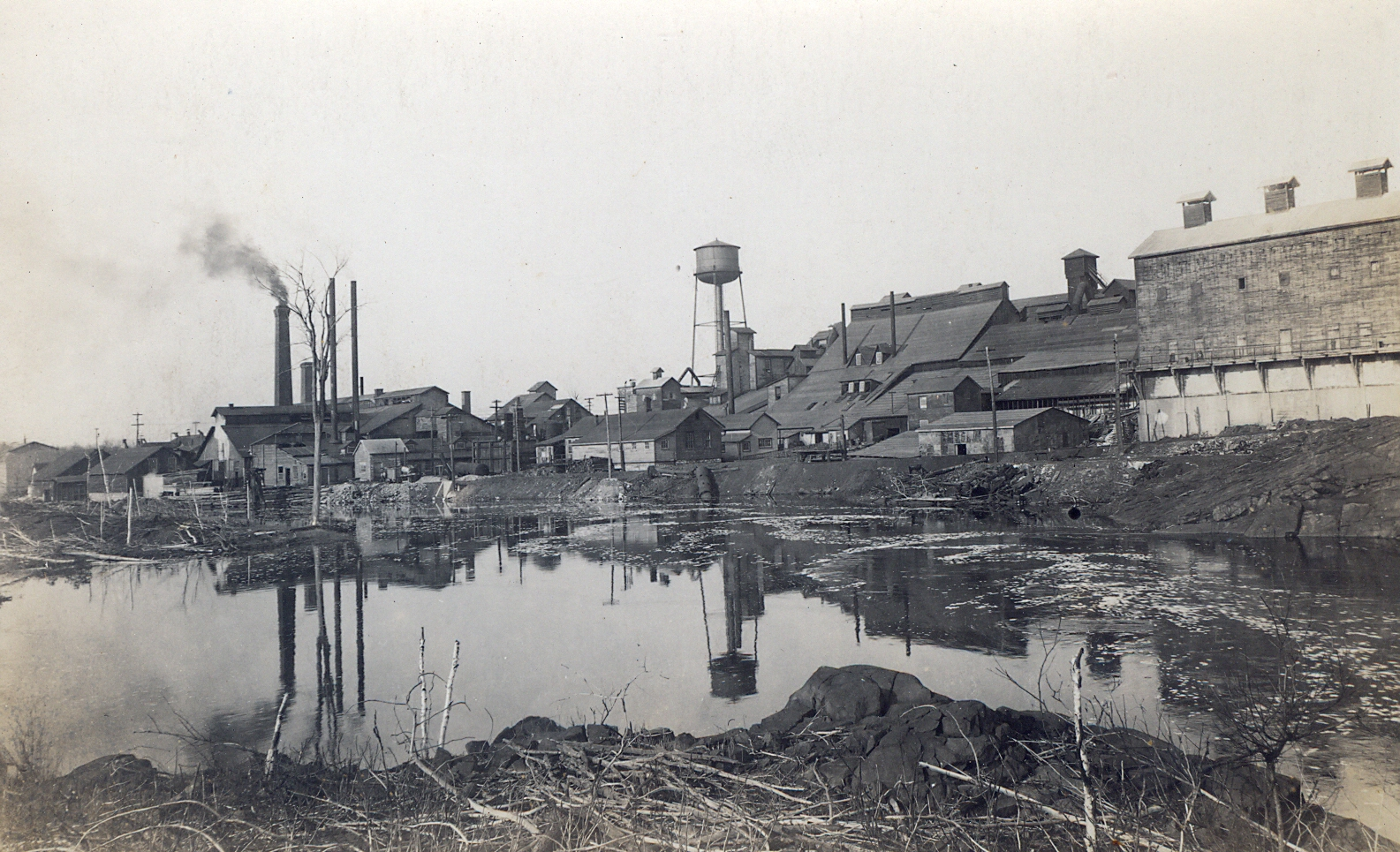 1916 Deloro Mine Site from the east bank of river. Note 1882 arsenic works centre still in use. Arsenic bag house on right; Cobalt oxides plant on left