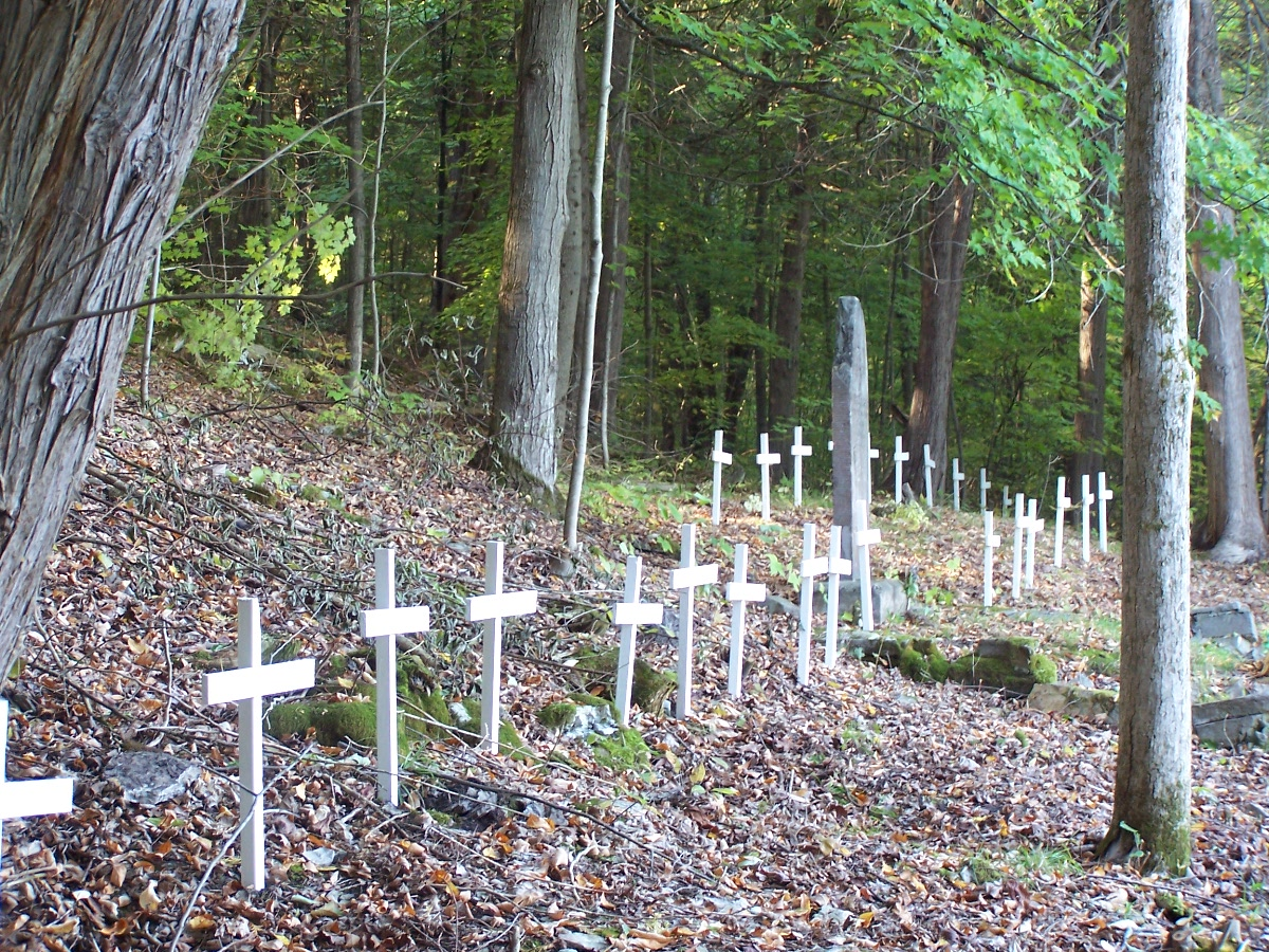 "wooden crosses placed on the ""suspected"" grave sites during a special ontario heritage ""open Doors"" event, 2005."