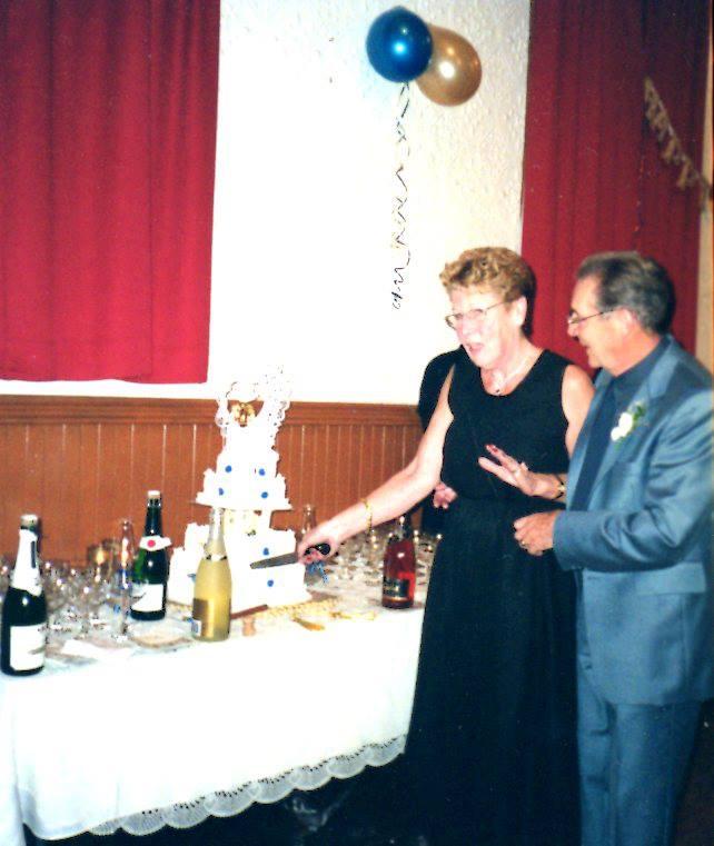 Marmora Town Hall - Helen & Syd Perkin cutting 50th wedding anniversary cake!