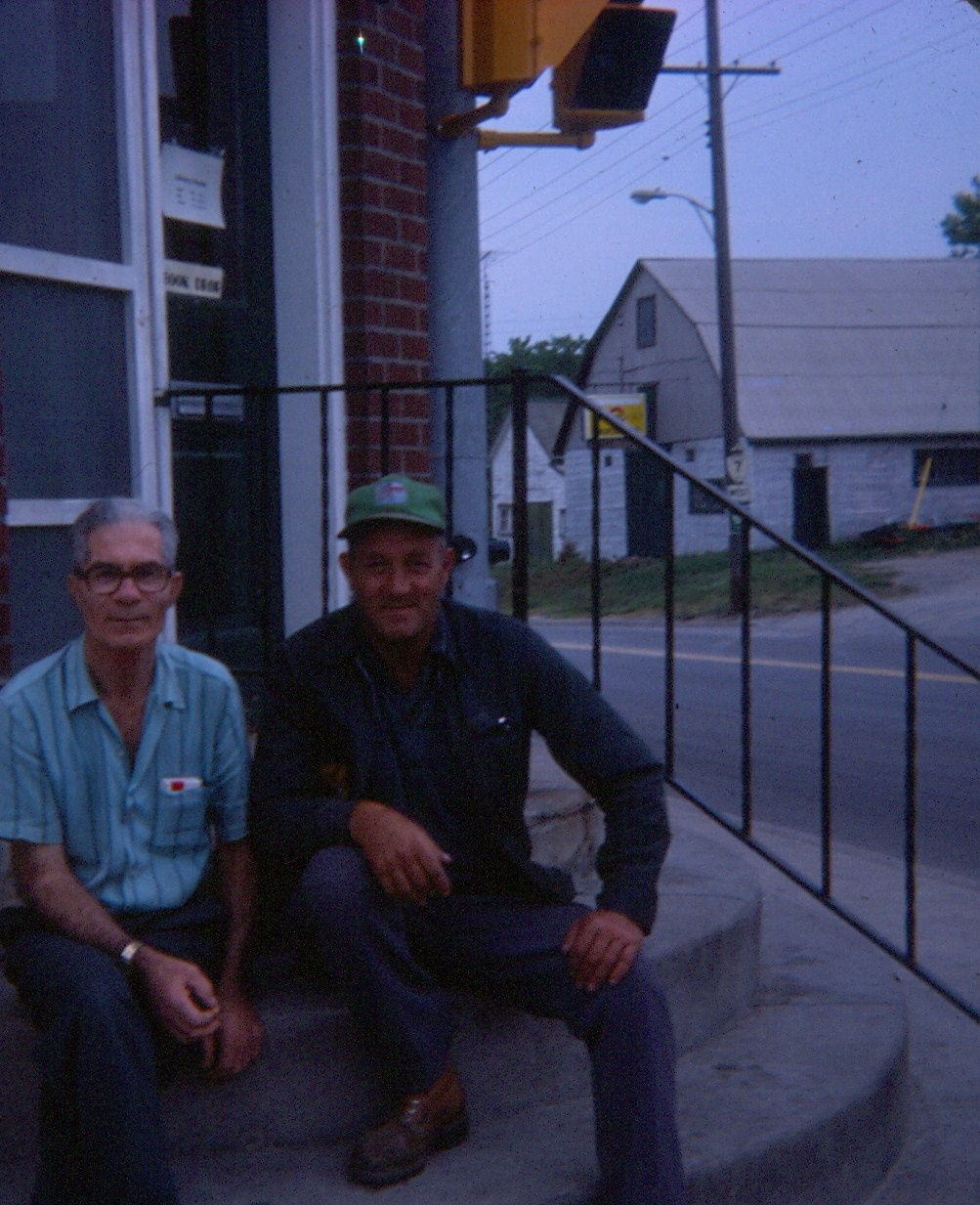 Hanging round the Library steps, 1977 bernard Forbes on the right. The fellow in the blue shirt is Kenny Hartin, brother Dave Hartin who lived on the Beaver Creek Settlement Road.