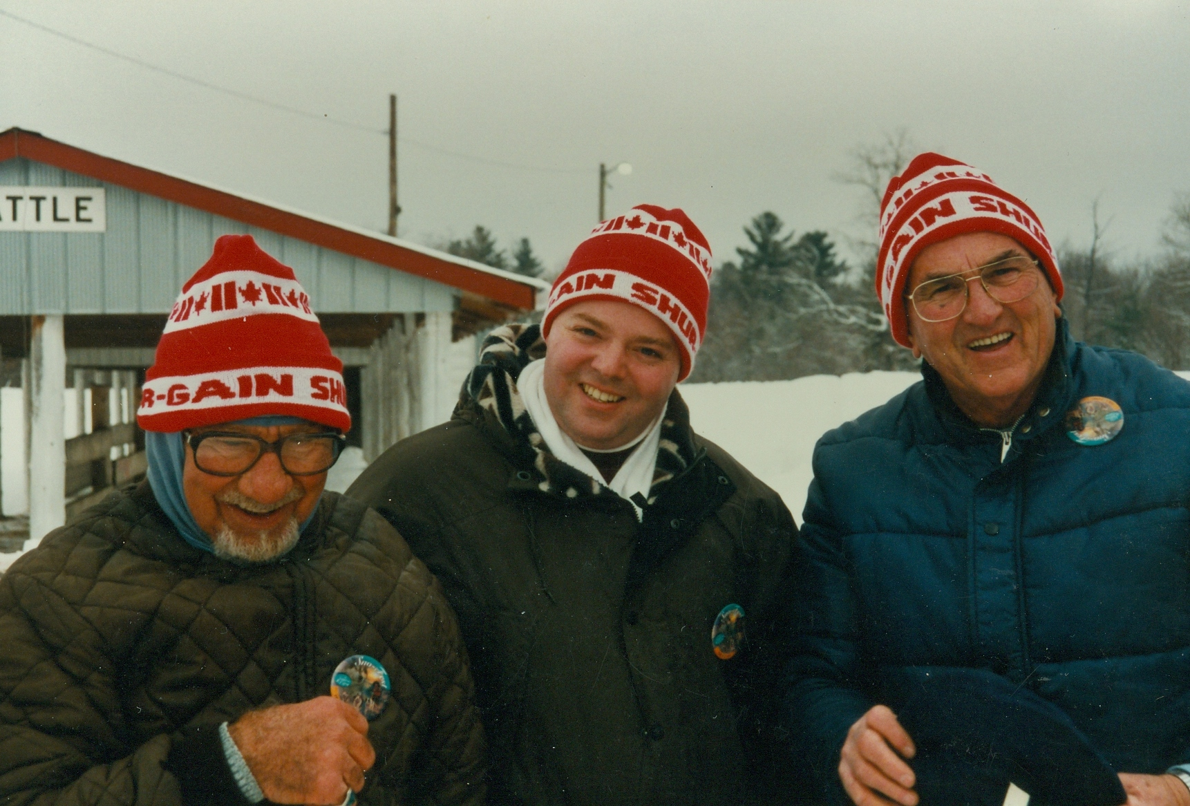 Tom Bedore and Leo Auger with a Snofest Sales rep between them