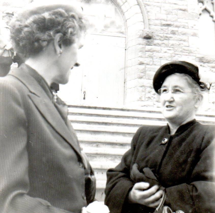 Helen (Gallagher) McKinnon chatting with Mrs. Jack Doyle in front of Sacred Heart Church - mother of Bernard & Bill Doyle & their sisters.