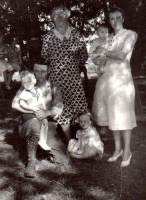 Standing Maggie Connors Gallagher with daughter, . Helen Gallagher McKinnon holding Don McKinnon. Sitting Frank McKinnon with Bob McKinnon, Wilma McKinnon sitting