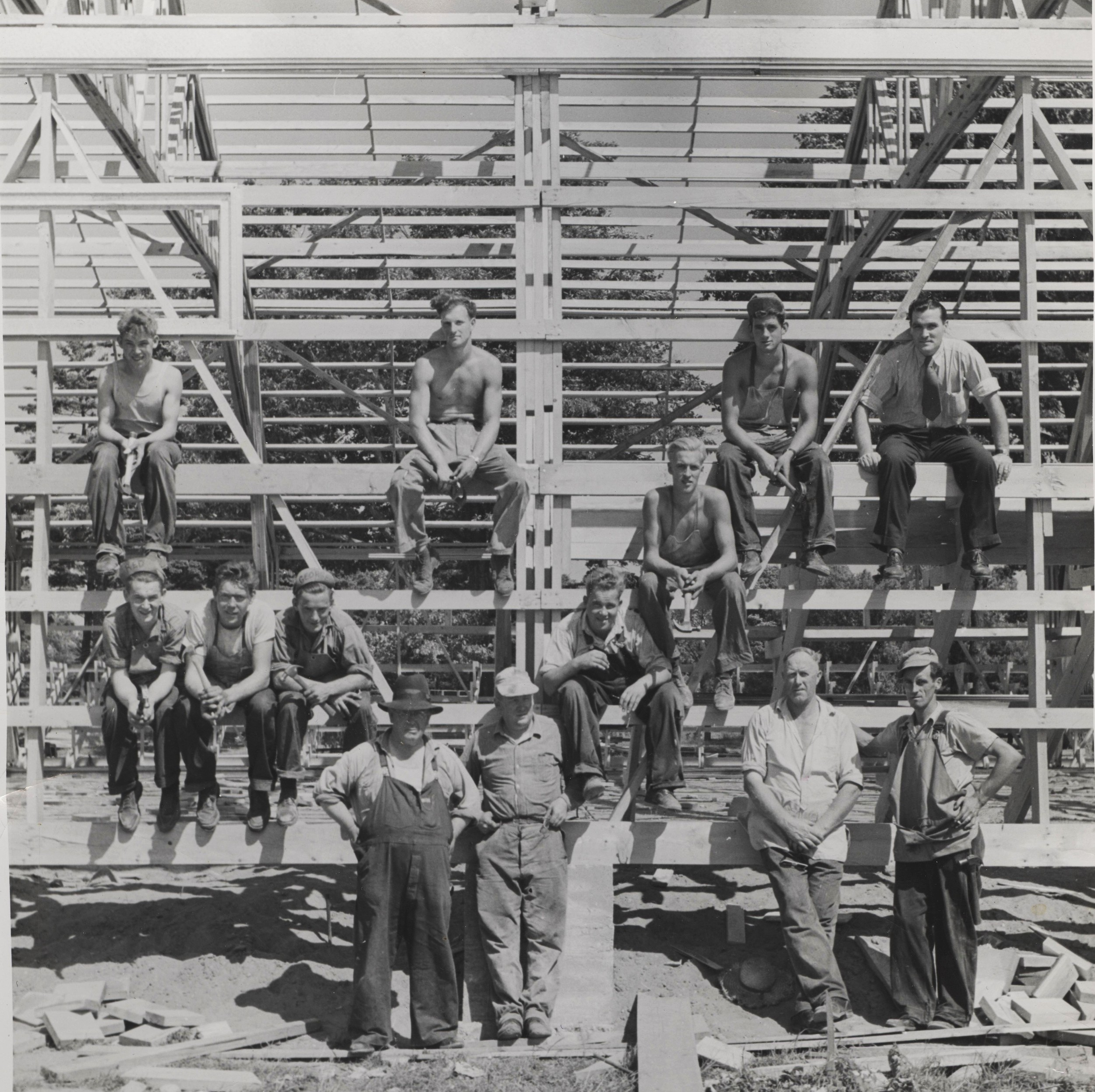 BUILDING THE FIRST ARENA 1948   Top l - r - Robert maynard (contractor's son, ray black, ed waddle, bill shannon,  SECOND ROW : DOUG WHAN,  THIRD ROW L-R:  aLLAN MAYNARD (CONTRACTOR'S SON), mURRAY MCKINNON, GEORGE MAYNARD (CONTRACTOR'S SON), ALFRED MAYNARD (CONTRACTOR'S SON)  FRONT ROW L-R - gEORGE hENRY mAYNARD (CONTRACTOR), MARK MAYNARD (CONTRACTOR'S SON), iRVIN mCCOY (FATHER OF mARJORIE MCFAUL) JIM CRAWFROD (FATHER OF JANET O'NEILL)