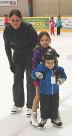 Coach Melanie Barker looking on, Kennedy Croskery gave young learner Gary Baskin a helping hand.jpg