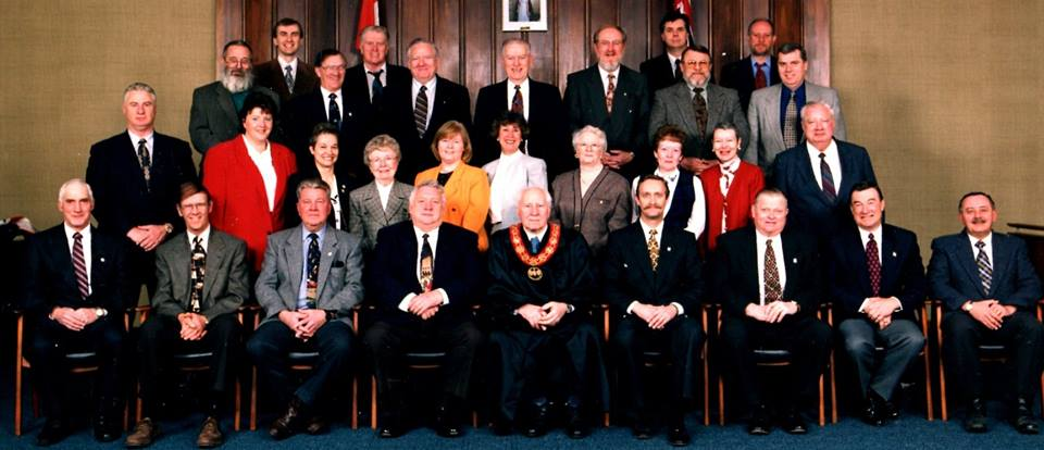 "Normal   0           false   false   false     EN-CA   X-NONE   X-NONE                                                                                  Hastings Country Council, 1998: Back: Brent Dagleish, Carl Tinney, Lionel Bennett, Eric Fry; 3rd Row: Dave Panabaker, Doug Mumford, Glenn Belcour, Wes Moffatt, Garry Jewel, Rob McLaughlin, Jim Duffin; 2nd Row: Doug Kruger, Debby Smart, Claudette Dignard-Remillard, Margaret Walsh, Jean Rixen, Dawn Holcombe, Marian Bastedo, Wilma Bush, Gil Sparrow, Arnold Burkitt; Front: Dean Foster, Bill Altoft, Lloyd Churchill, Warden Albert Vader, Willem Bouma, Gerald Reid, MPP Harry Danford, Tom Deline                                                                                                                                                                                                                                                                                                     /* Style Definitions */  table.MsoNormalTable 	{mso-style-name:""Table Normal""; 	mso-tstyle-rowband-size:0; 	mso-tstyle-colband-size:0; 	mso-style-noshow:yes; 	mso-style-priority:99; 	mso-style-qformat:yes; 	mso-style-parent:""""; 	mso-padding-alt:0cm 5.4pt 0cm 5.4pt; 	mso-para-margin-top:0cm; 	mso-para-margin-right:0cm; 	mso-para-margin-bottom:10.0pt; 	mso-para-margin-left:0cm; 	line-height:115%; 	mso-pagination:widow-orphan; 	font-size:11.0pt; 	font-family:""Calibri"",""sans-serif""; 	mso-ascii-font-family:Calibri; 	mso-ascii-theme-font:minor-latin; 	mso-fareast-font-family:""Times New Roman""; 	mso-fareast-theme-font:minor-fareast; 	mso-hansi-font-family:Calibri; 	mso-hansi-theme-font:minor-latin;}"