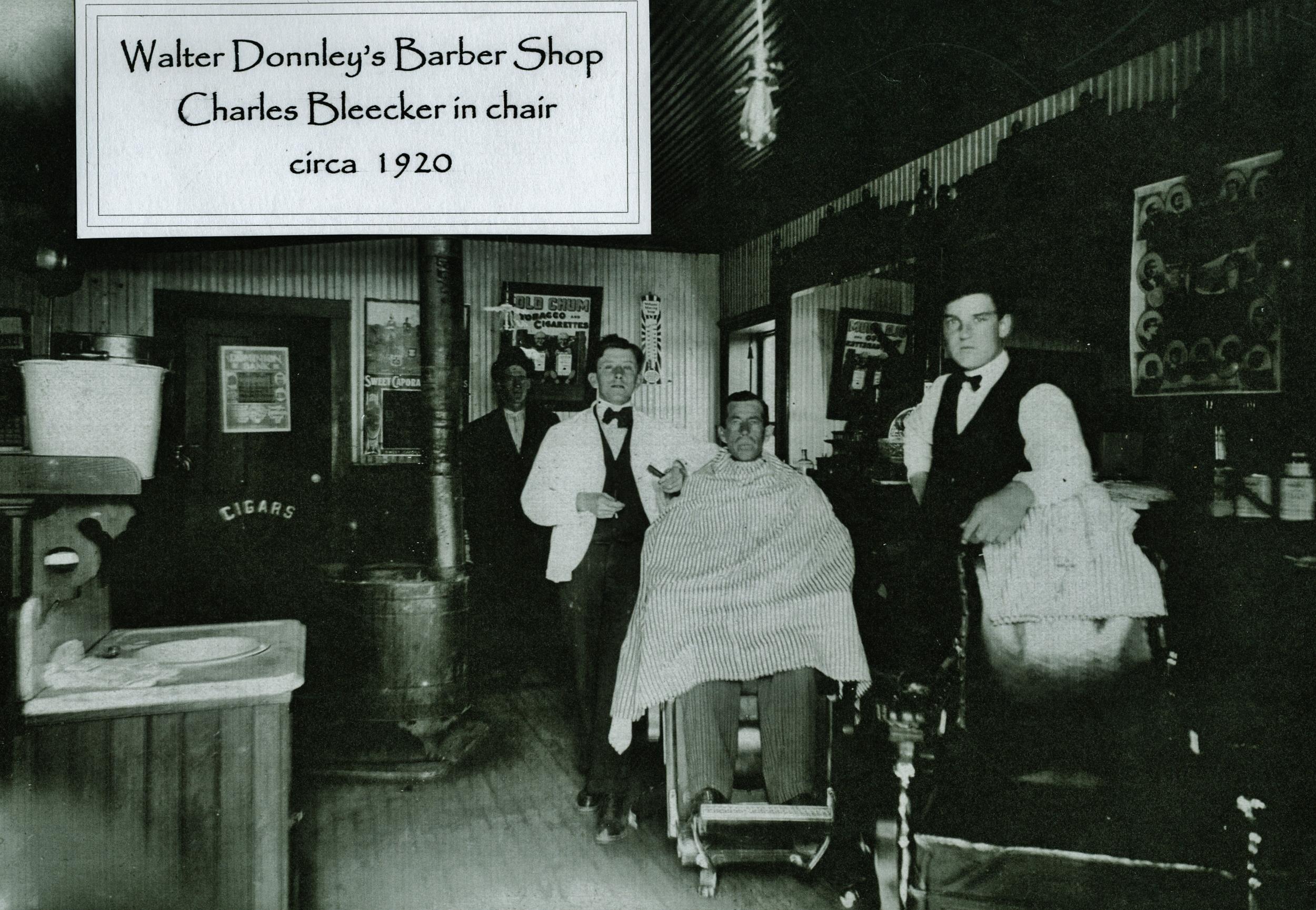 Walter Donnley's Barber Sbop, Charles Bleecker in chair c. 1920