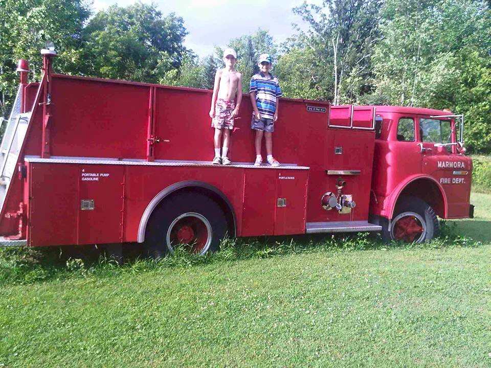 Old Marmora Fire truck, now resting at a farm, round lake