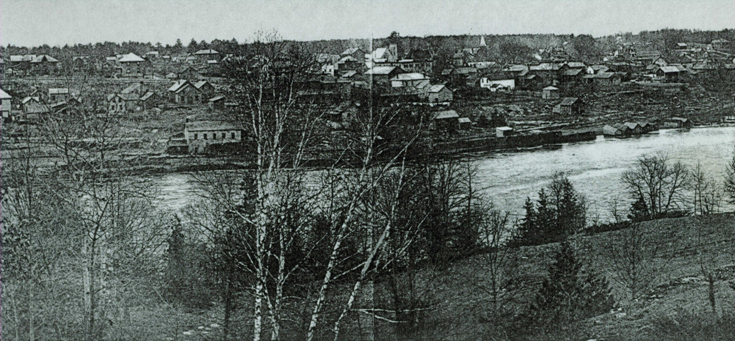 1920 View of the river looking east at the soap factory with its roof