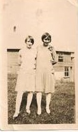Mildred (later campion) and Marguerite Finnegan (later sister mary bernard), , daughters of John Finnegan. standing outside the cheese factory