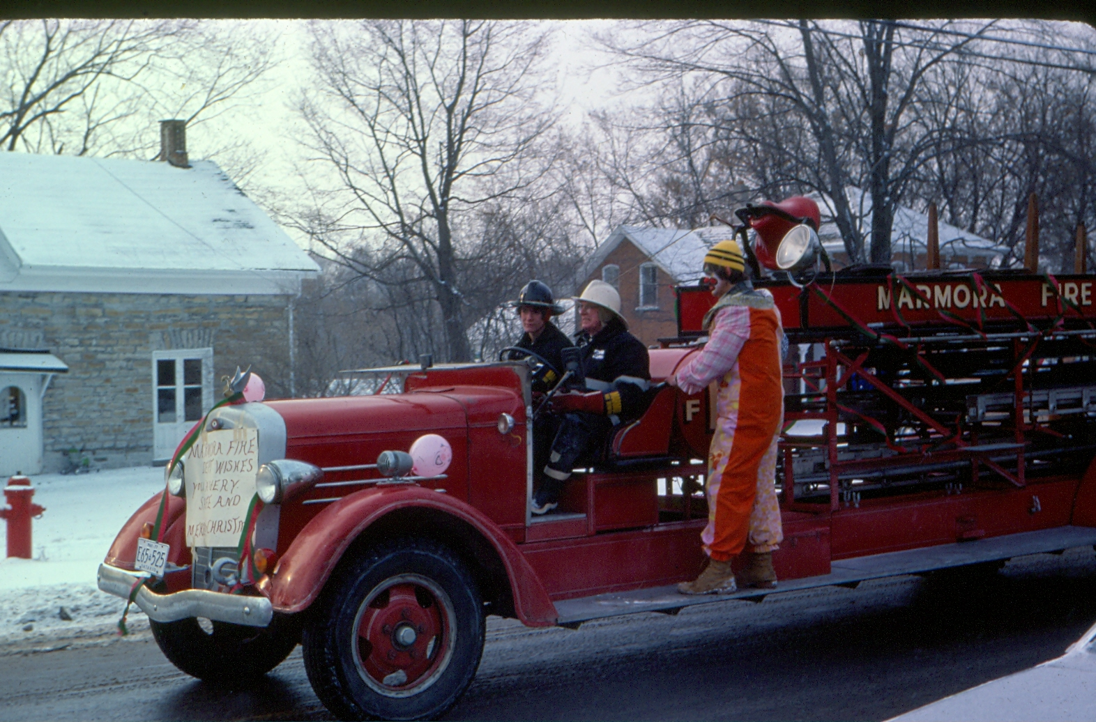 Rick Airhart, Les McKeown driving and Robert Derry, in front of 47 Forsyth St, Marmora