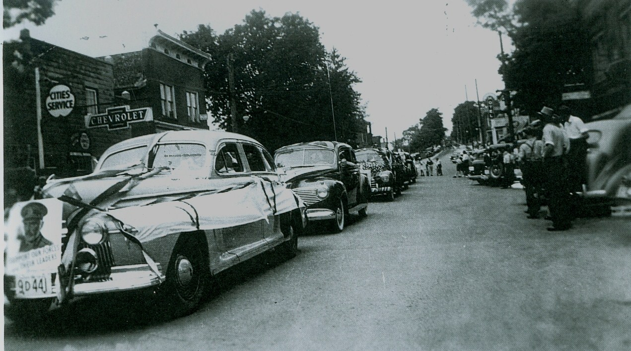 Parade down business section,  George Forestell garage.jpg