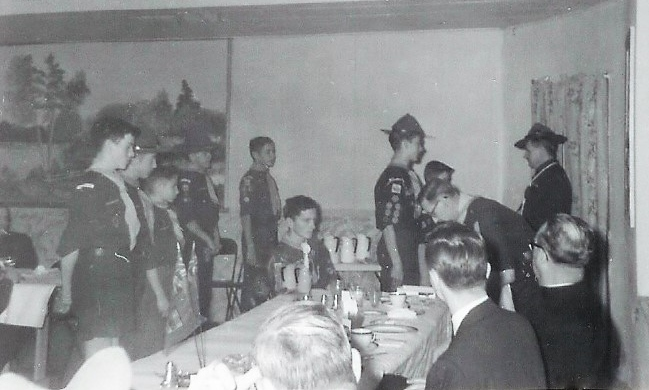 1959 Wayne VanVolkenburg receiving the gold cord. left side - Paul Auger, 4th. John Bedore, 5th Brian Goodchild, sitting- Mike Auger, to my left Ron Gray. Ernie Harvey presenting the award, Jack Coulthard bending over.