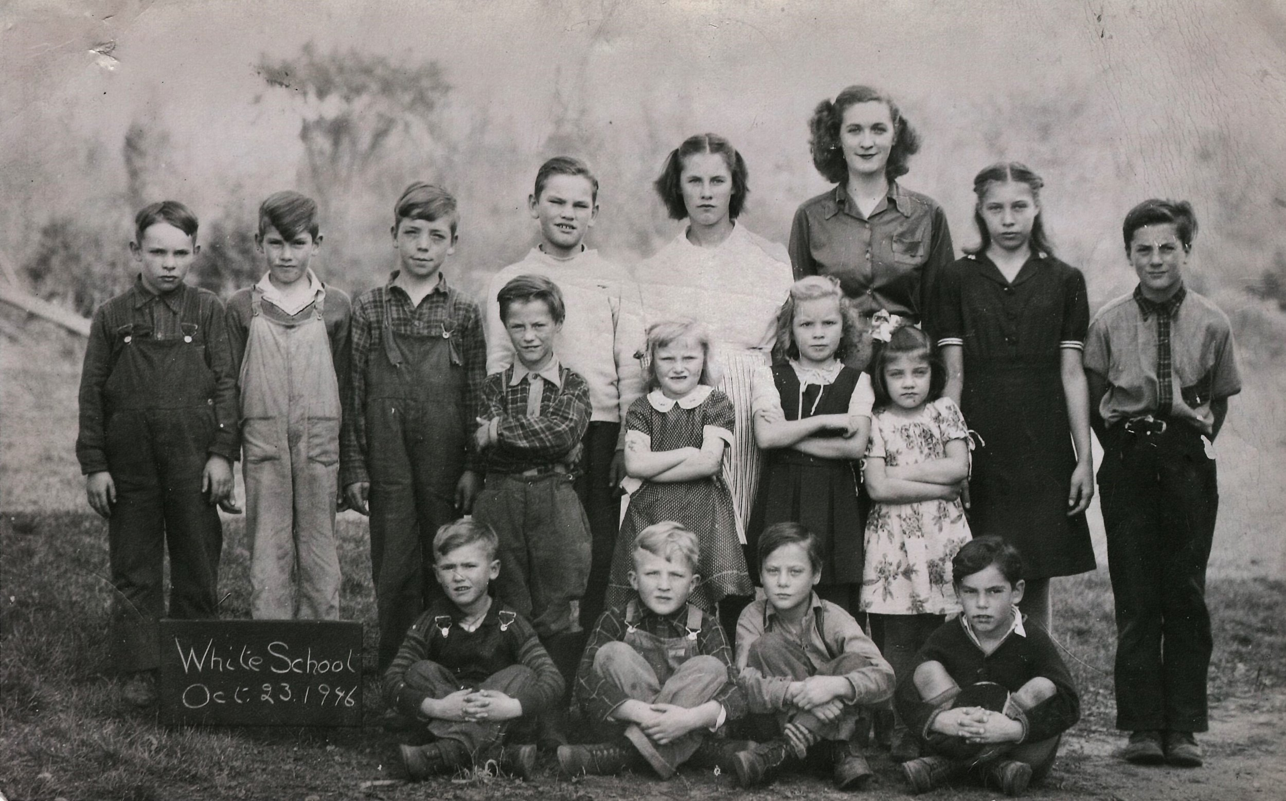 """WHITE SCHOOL 1946. BACK ROW - 4TH BOY TO THE RIGHT JOHN """"JACK"""" CLEMENS, DOROTHY HULSMANS, TEACHER, UNKNOWN GIRL, LEO HULSMANS (MY DAD) AT THE END STANDING. 2ND ROW BOY STANDING: DAVID HULSMANS, BESIDE HIM JEAN HULSMANS. FRONT ROW SITTING 3RD BOY HENRY HULSMANS. John Clemens is front row far right."""