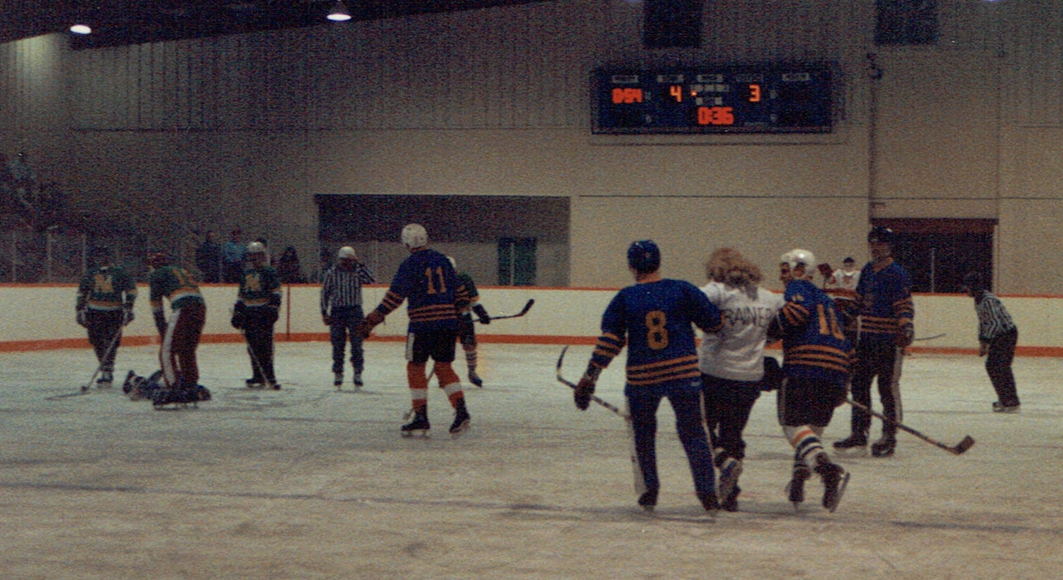 Trainer, Wally Sawkins escorted off the ice for a job badly done.