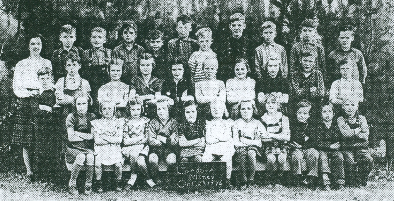 1946 Junior room, (l to r) Teacher, Rita Coss, Bob Colby, George Wiggins, Harold Ellis, David Saunders, Russell Wiggins, unknown, John. Chard, Don Pressick, Keith Wiggins, Gerard Fehrenbach, (m, Ito r) Jack Pressick, Keith Hamilton, Joan Anderson. Gena Kennedy, Ruth Hicks, Huda McCurdy, Lois Hicks, Priscilla Pressick, Don MacFarlane, Orville Edwards, (f, Ito r)Anne Saunders, Joanne Barrons, Wahnetia Edwards, Marilyn Pierce, Ruth Cole, Arlene Campion, Shirely McQuigge, Dorothy Ellis, Ronnie Pierce, Don Ellis, and George McQuigge.