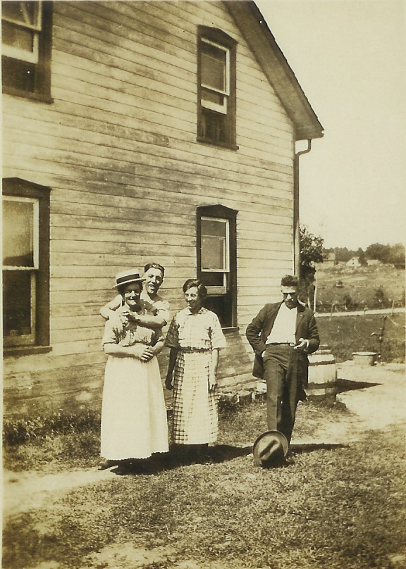 1934 Back (west side) of house. Sarah, Harry, Alice and cousin Milo VanVolkenburg