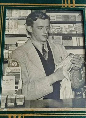 Leo O'Connor working at the drug store.