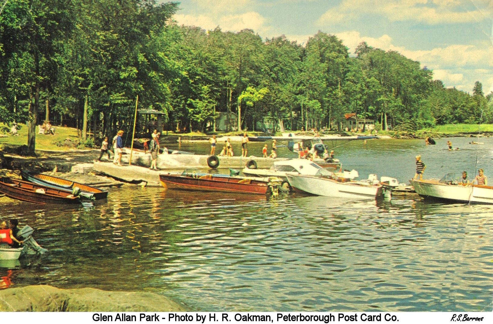 From Ron Barrons: one of those rare Oakman photographs taken from ground level.  The card says 'Glen Allan Park on the north shore of Crowe Lake - 15 housekeeping cottages. Trailer and camping facilities. Safe sandy beach, recreation building, boats and motors, ice. Good fishing. Write Vern and Ethel Caverly...'