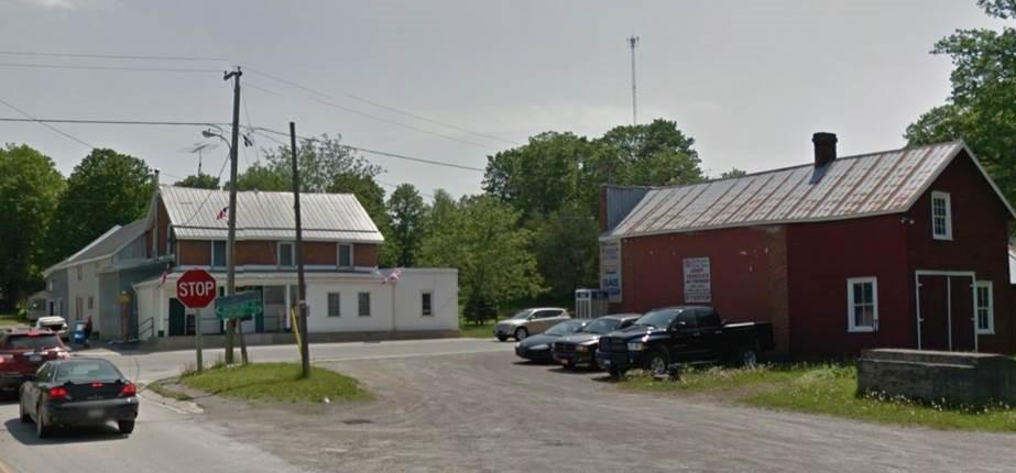 left - Mumby & Rollins store (SE corner ) and right, the Bateman store (SW corner)