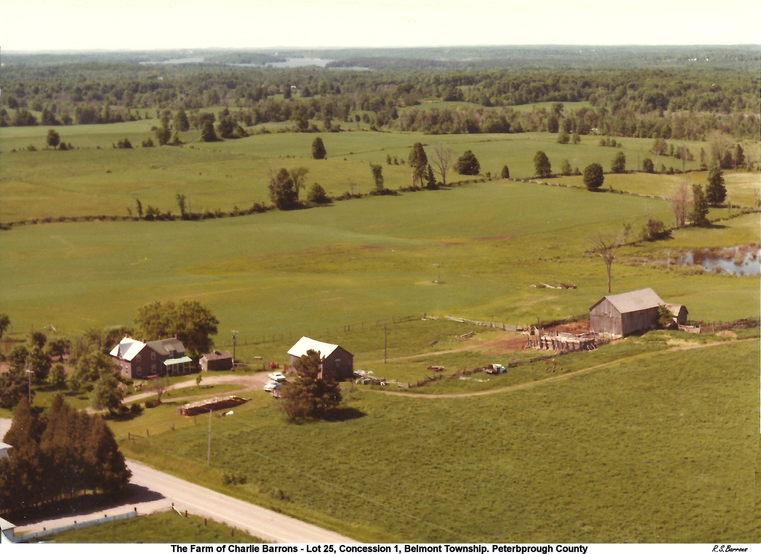 the homestead of George Barrons,  where he and Lena (Steenburgh) raised their seven children and where Charlie  Barrons and Freda (Ellis) raised their four children. That's Belmont Lake in  the background.