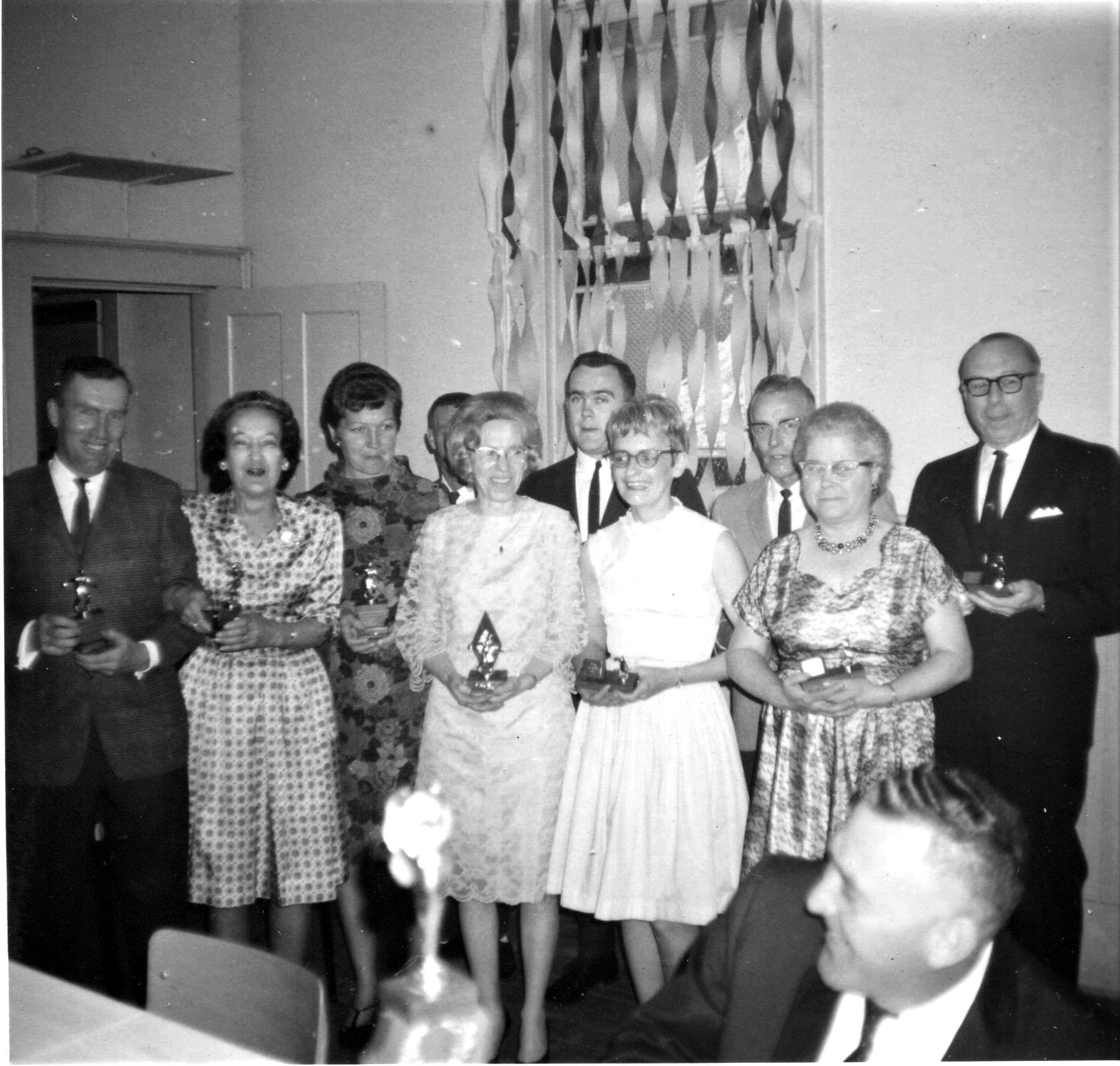 Shirley Pressick in the white dress, Bernard Doyle sitting at the table.Third from left flowered dress Isabelle Goodchild and Don Goodchild is in the back (half his head showing) Sally Jones on the Right.